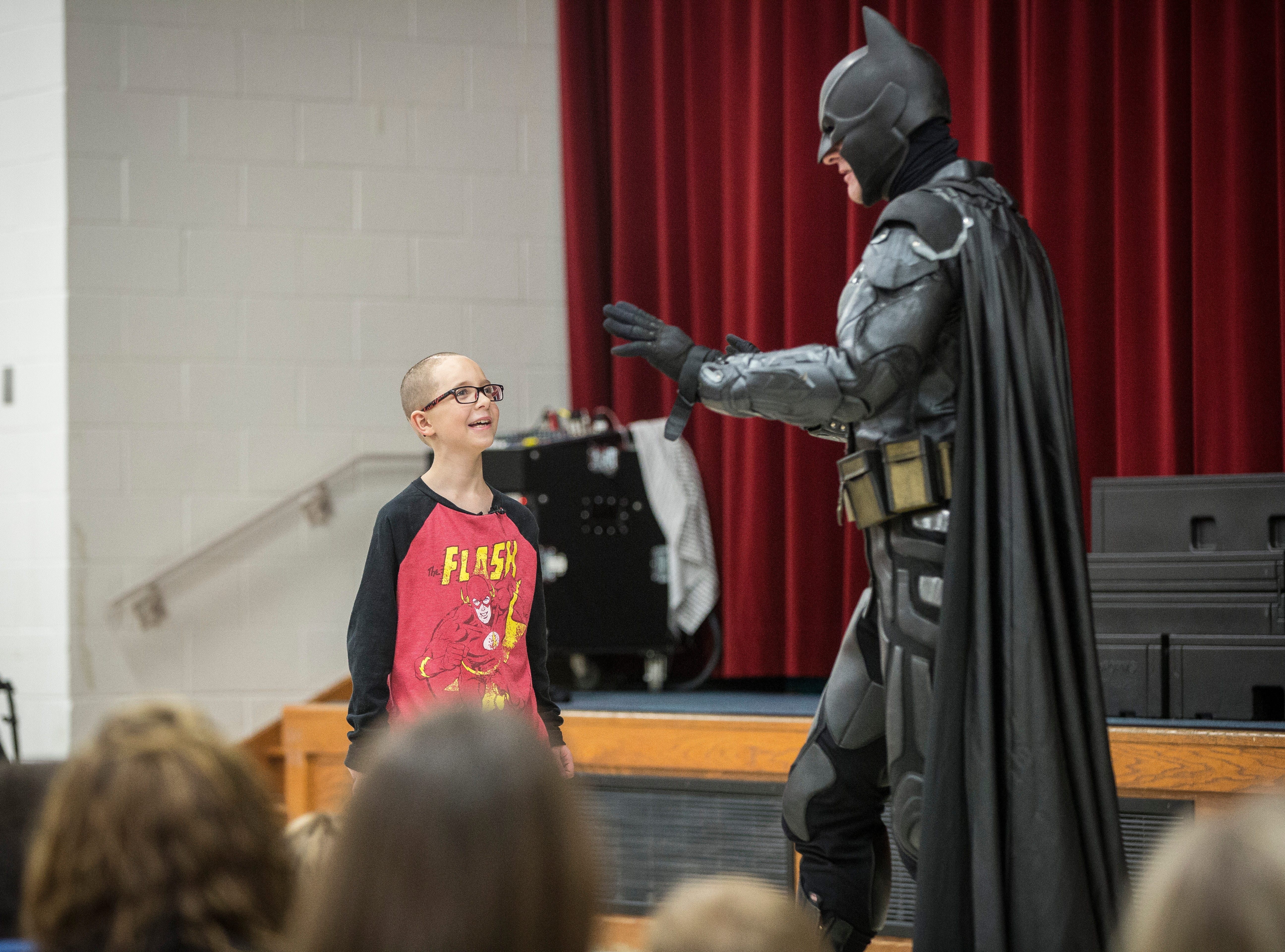 Christian Daugherty, a young Albany boy who was diagnosed with brain cancer, gets to meet Batman on Monday at Albany Elementary. Daugherty has been battling a rare form of brain cancer for nearly a year.
