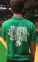 The back of the custom shirts made in support of New Castle basketball coach Daniel Cox.