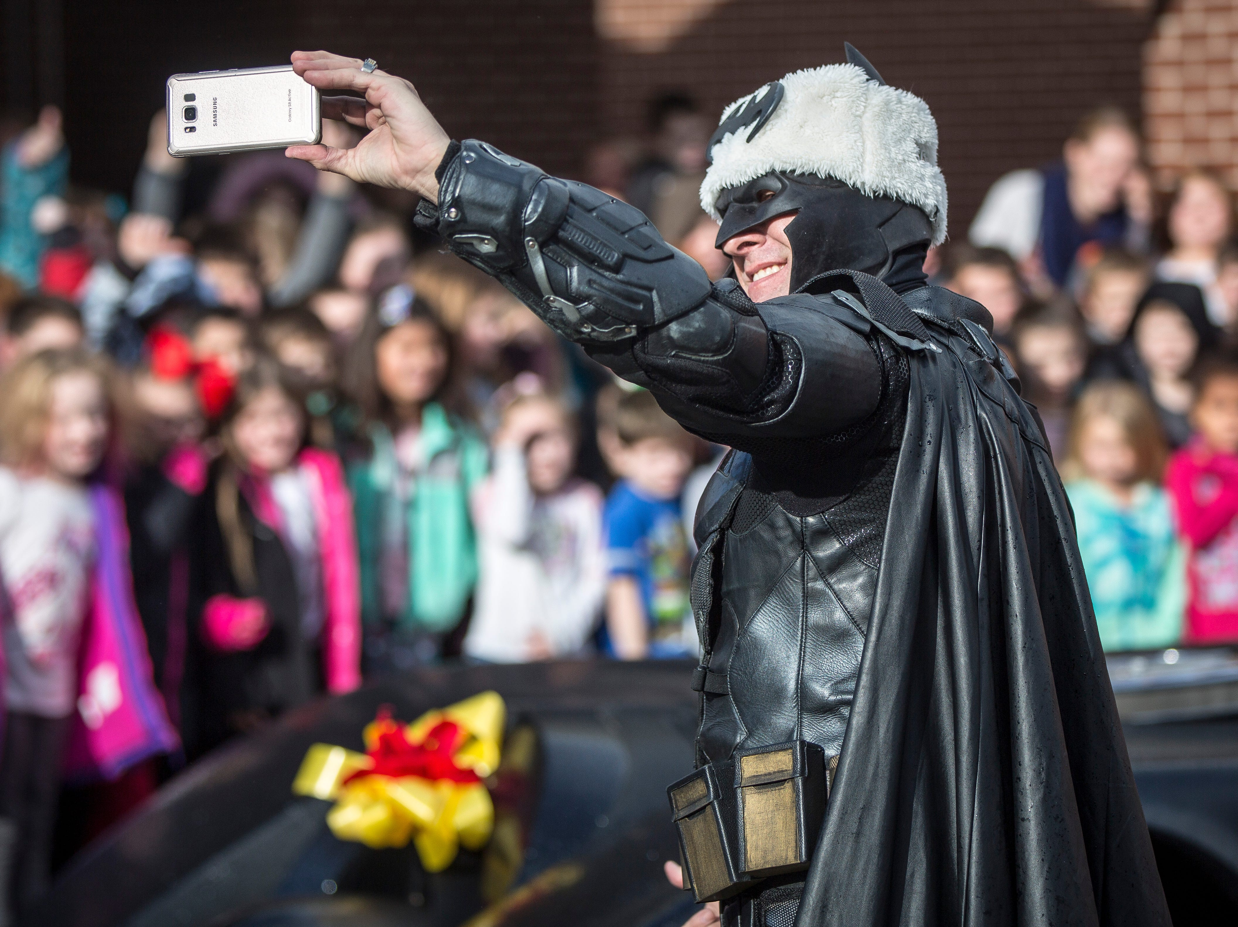 Batman came to Albany Elementary on Monday to visit Christian Daugherty, a young Albany boy who was diagnosed with brain cancer almost a year ago.