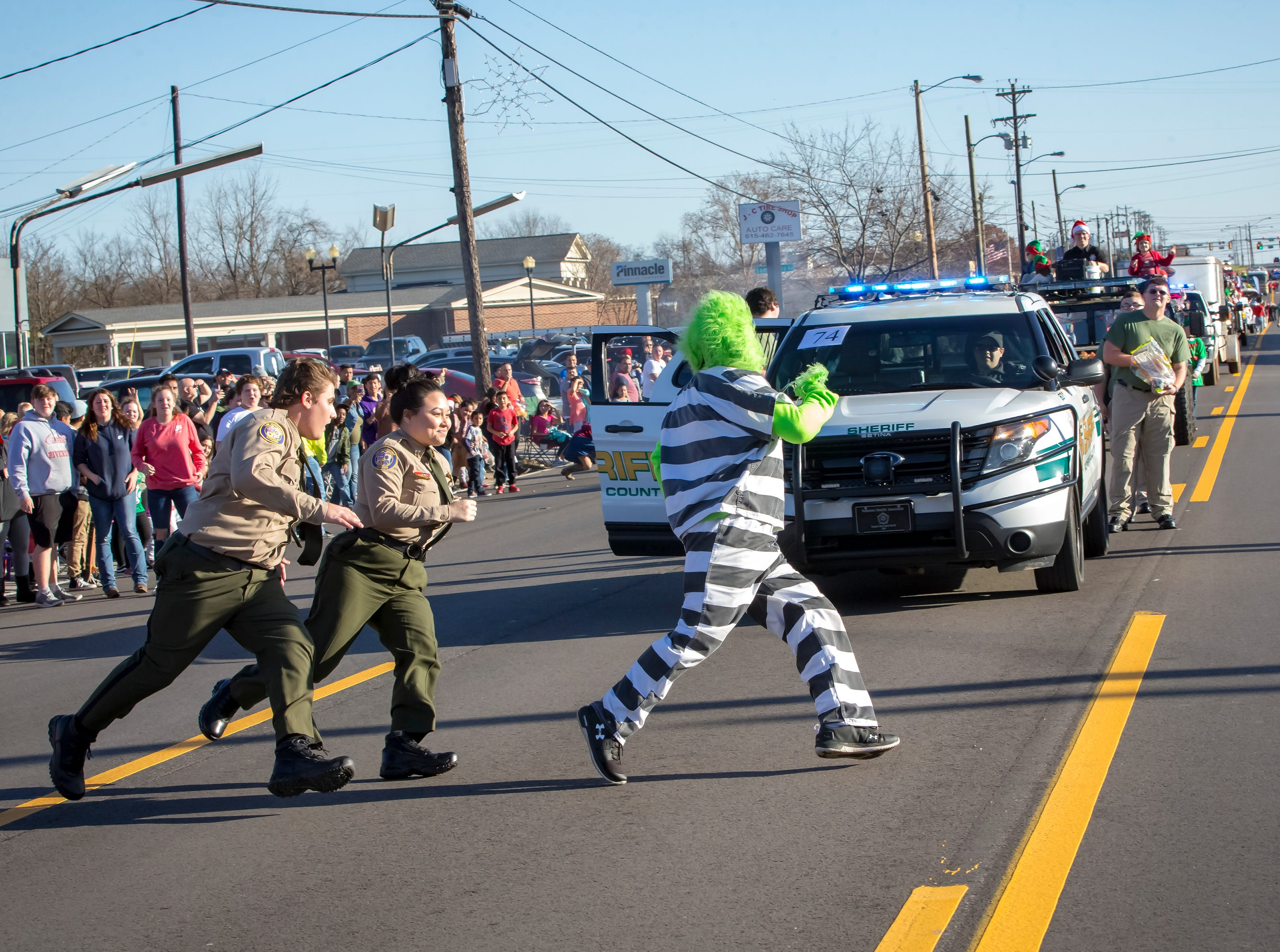 Rutherford County Sheriff's deputies make an effort to catch The Grinch Smyrna's 44th annual Christmas parade, held Sunday, Dec. 2, 2018.