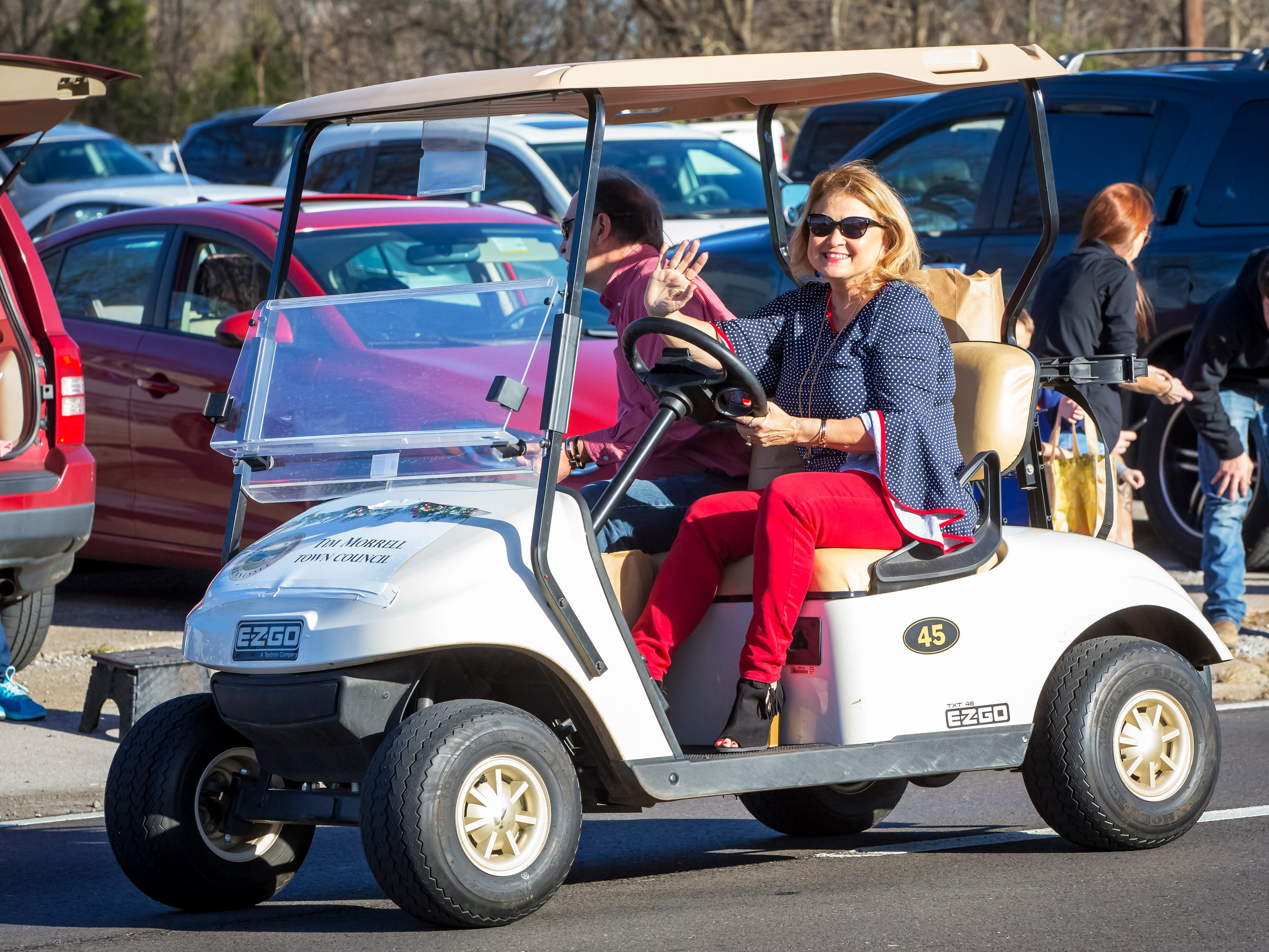 Smyrna's 44th annual Christmas parade was held Sunday, Dec. 2, 2018. Donna Morrell, wife of Councilman Tim Morrell waves to the crowd.