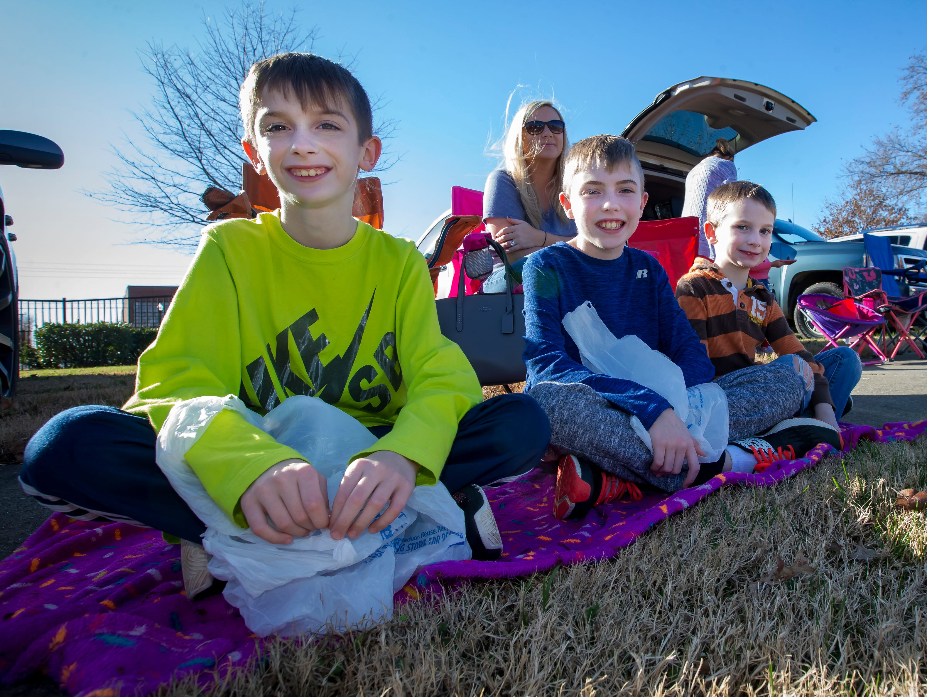 Alex, Aiden and Aston Lee wait for the start of the Smyrna Christmas parade.