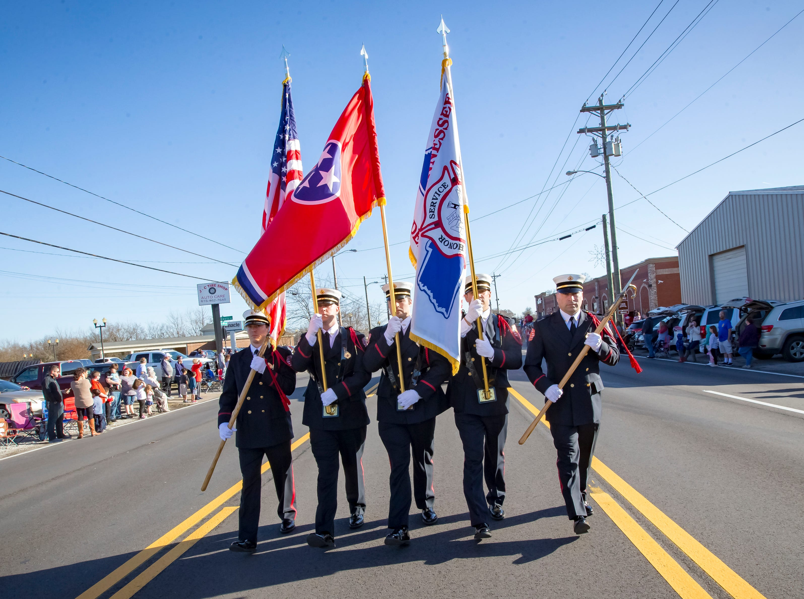 The Smyrna Fire Department Honor Guard leads the Smyrna Christmas parade.