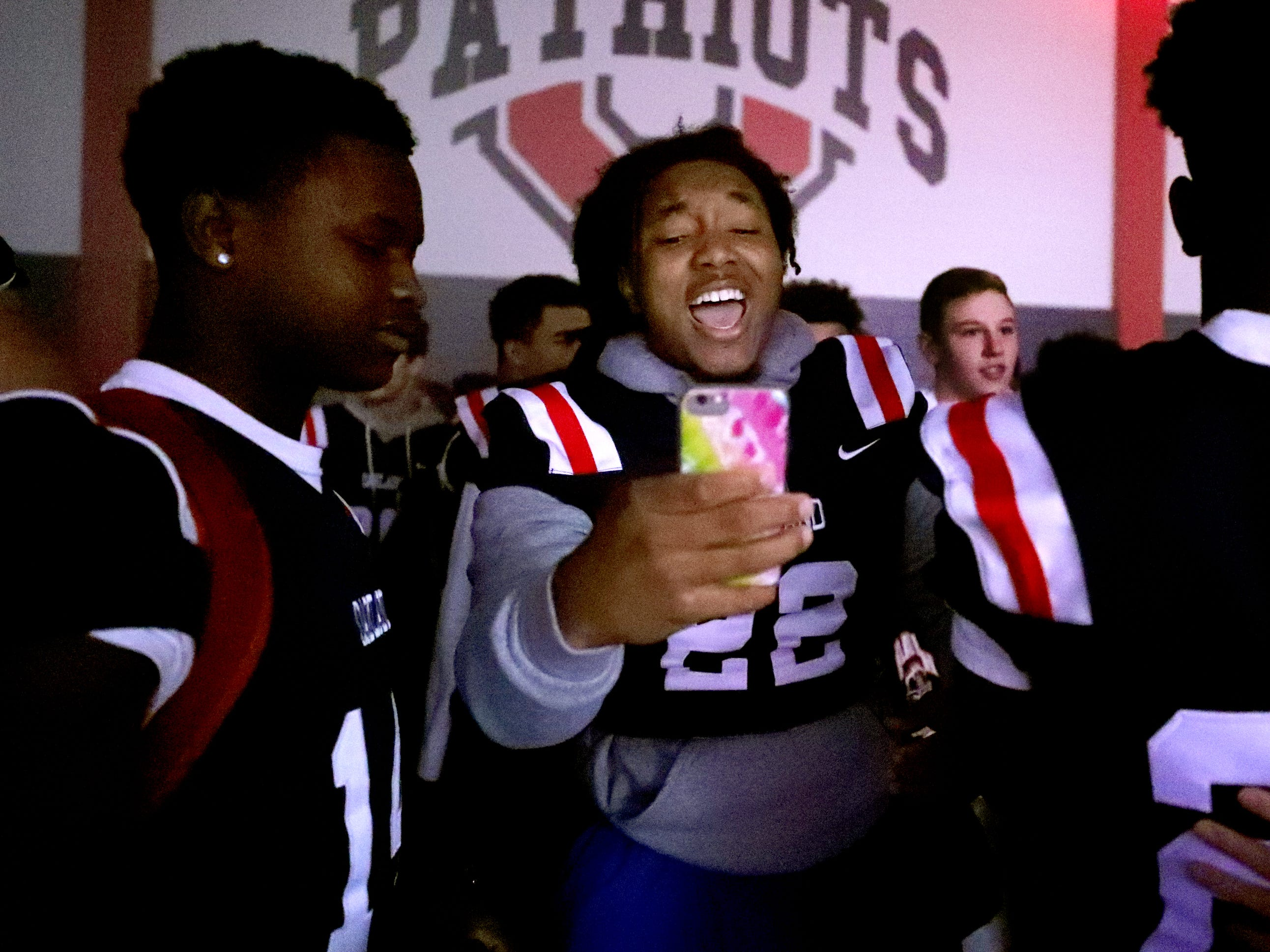 Oakland's Kameron Goodrich (14) and Oakland High School Ronnie Rankins (22) celebrate during a pep rally, on Monday, Dec. 3, 2018 at the school after the football team won the 6A State Championship BlueCross Bowl game against Westhaven on Thursday.