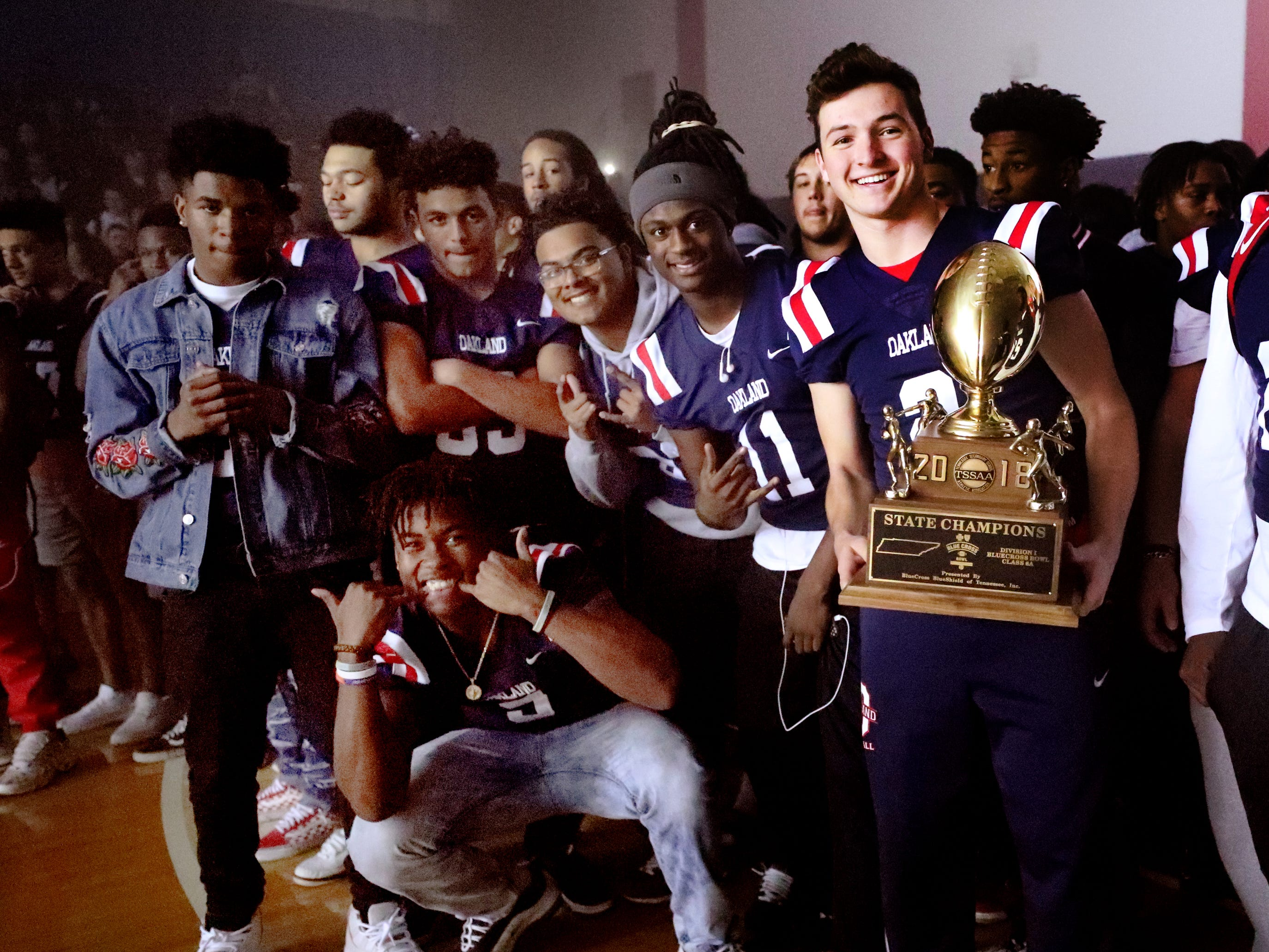 Oakland football players celebrate during a pep rally, on Monday, Dec. 3, 2018 at the school after the football team won the 6A State Championship BlueCross Bowl game against Westhaven on Thursday.