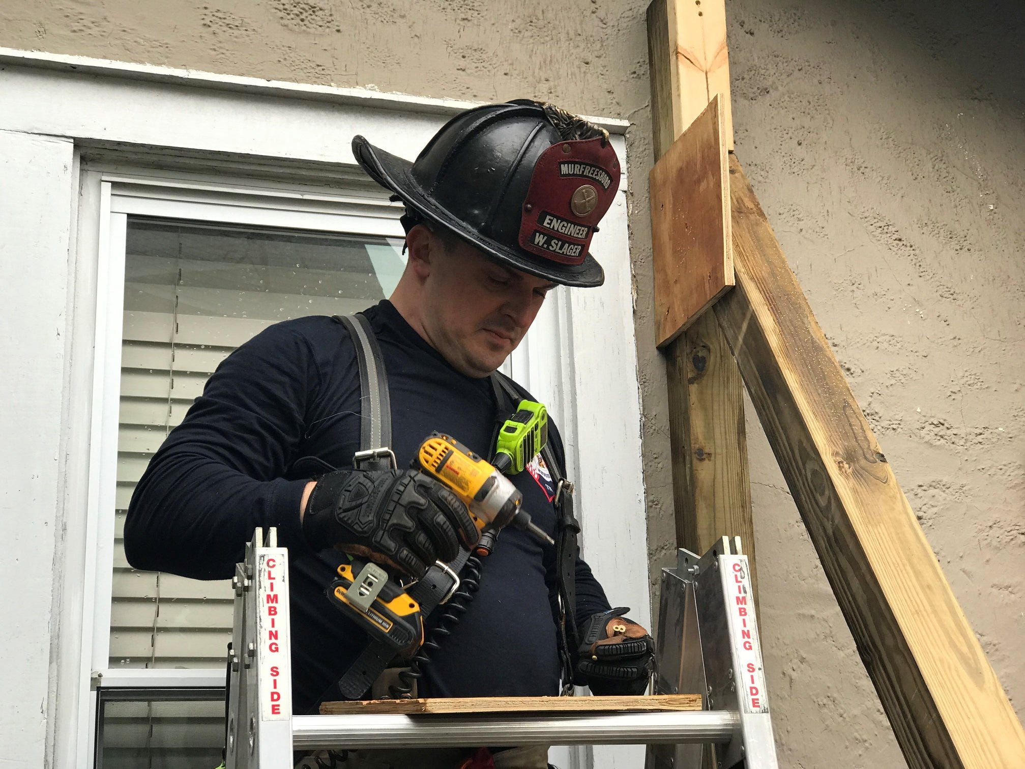 Members of Murfreesboro Fire and Rescue Department worked to shore up a home that had been damaged by a truck crashing through it Saturday, Dec. 1, 2018.
