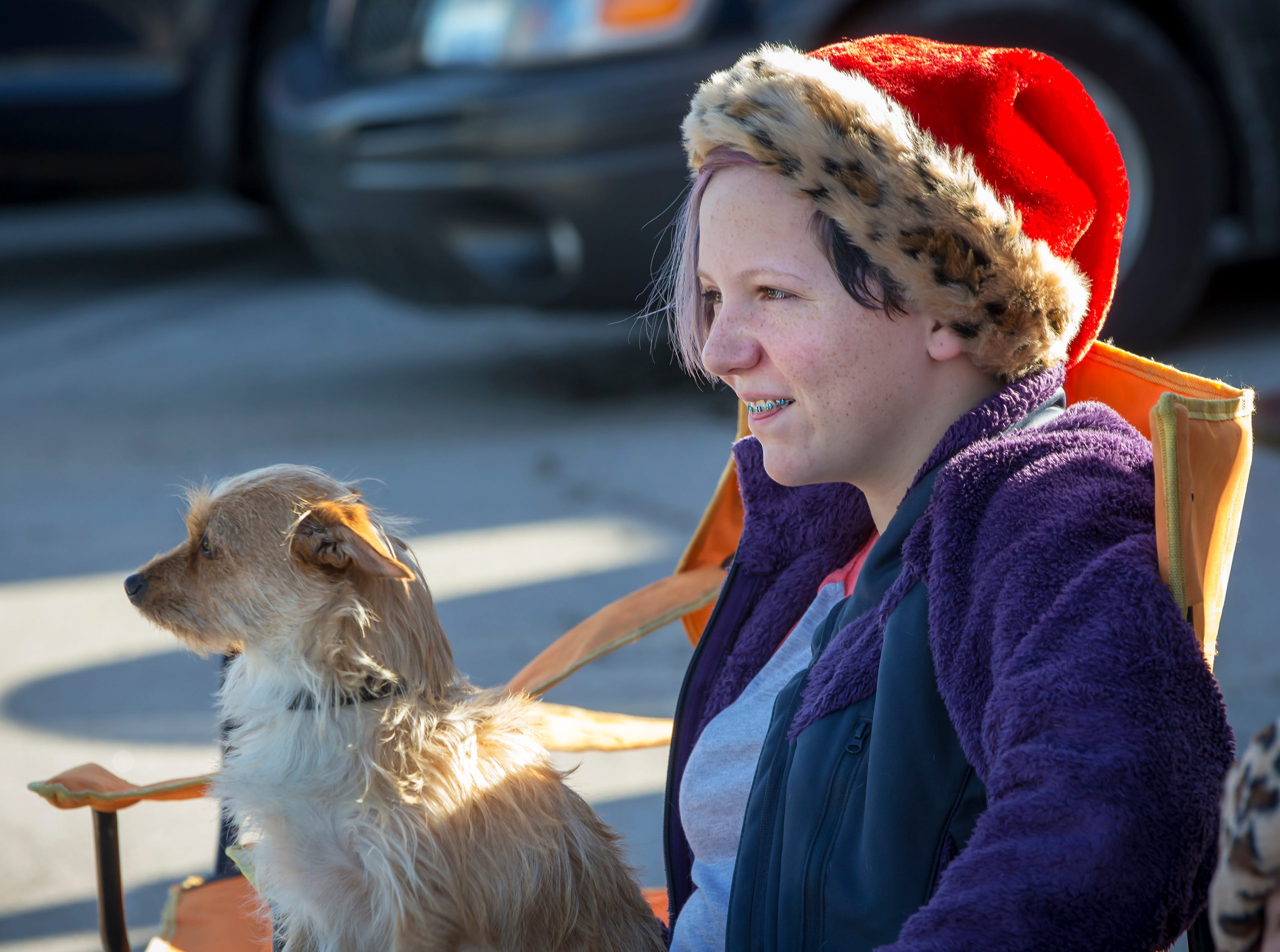Keira Wagner and dog Peanut wait for the Smyrna Christmas parade to start.