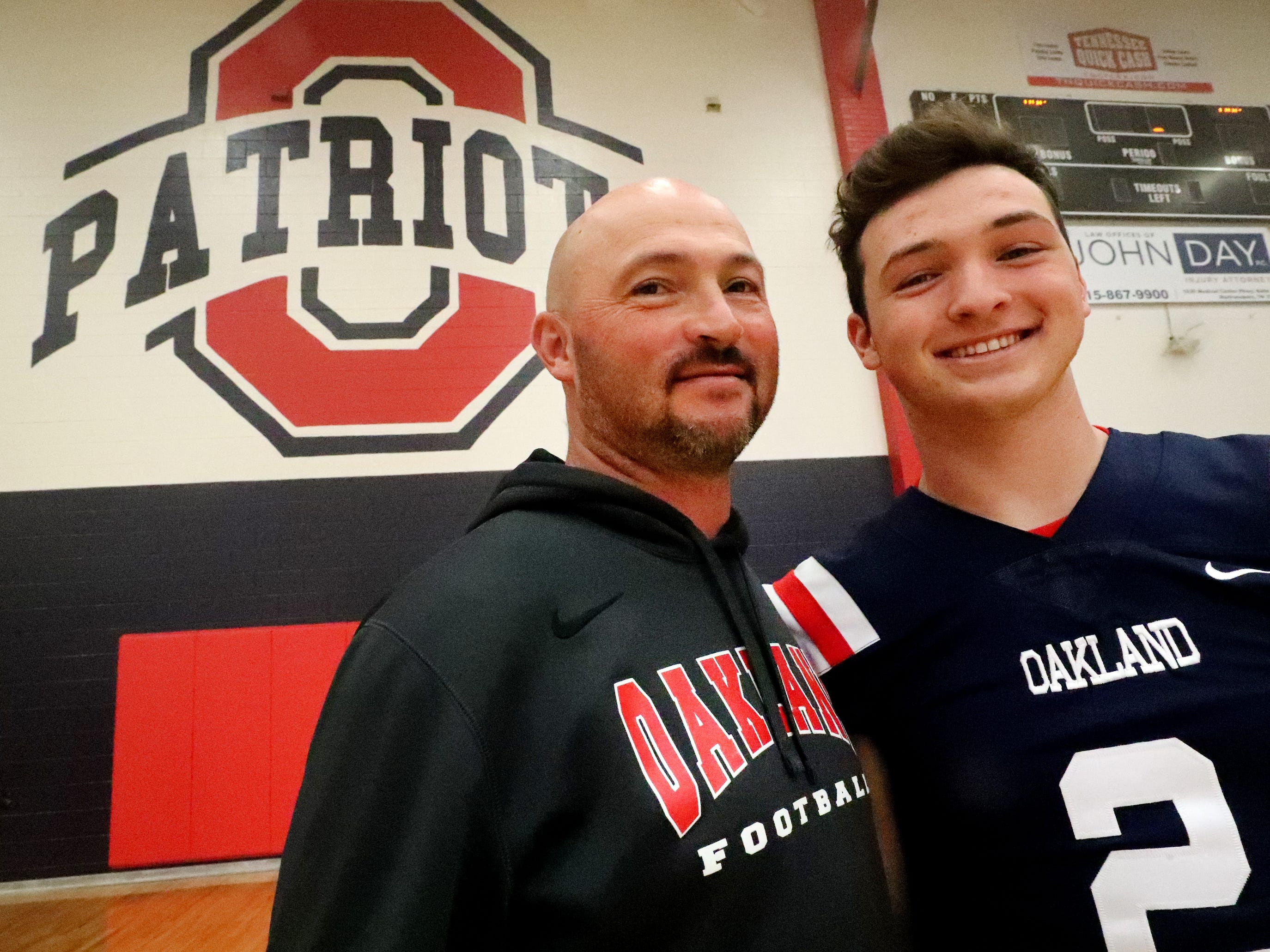 Oakland High School quarterback Brevin Linnell (2) with his dad Bryan Linnell after a pep rally, on Monday, Dec. 3, 2018 at the school after the football team won the 6A State Championship BlueCross Bowl game against Westhaven on Thursday.