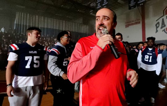 Oakland High School head coach Kevin Creasy speaks to the student body during a pep rally, on Monday, Dec. 3, 2018 at the school after the football team won the 6A State Championship BlueCross Bowl game against Westhaven on Thursday.