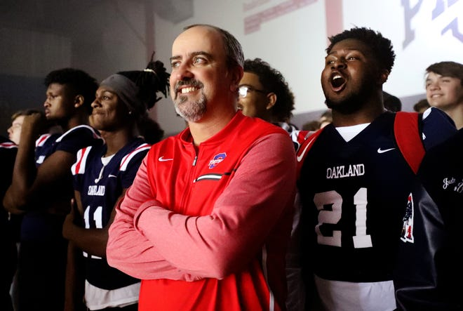 Oakland's Malik Sibert (11), head coach Kevin Creasy and Christian Cantrell (21) celebrate as the school holds a pep rally, on Monday, Dec. 3, 2018 at the school after the football team won the 6A State Championship BlueCross Bowl game against Westhaven on Thursday.