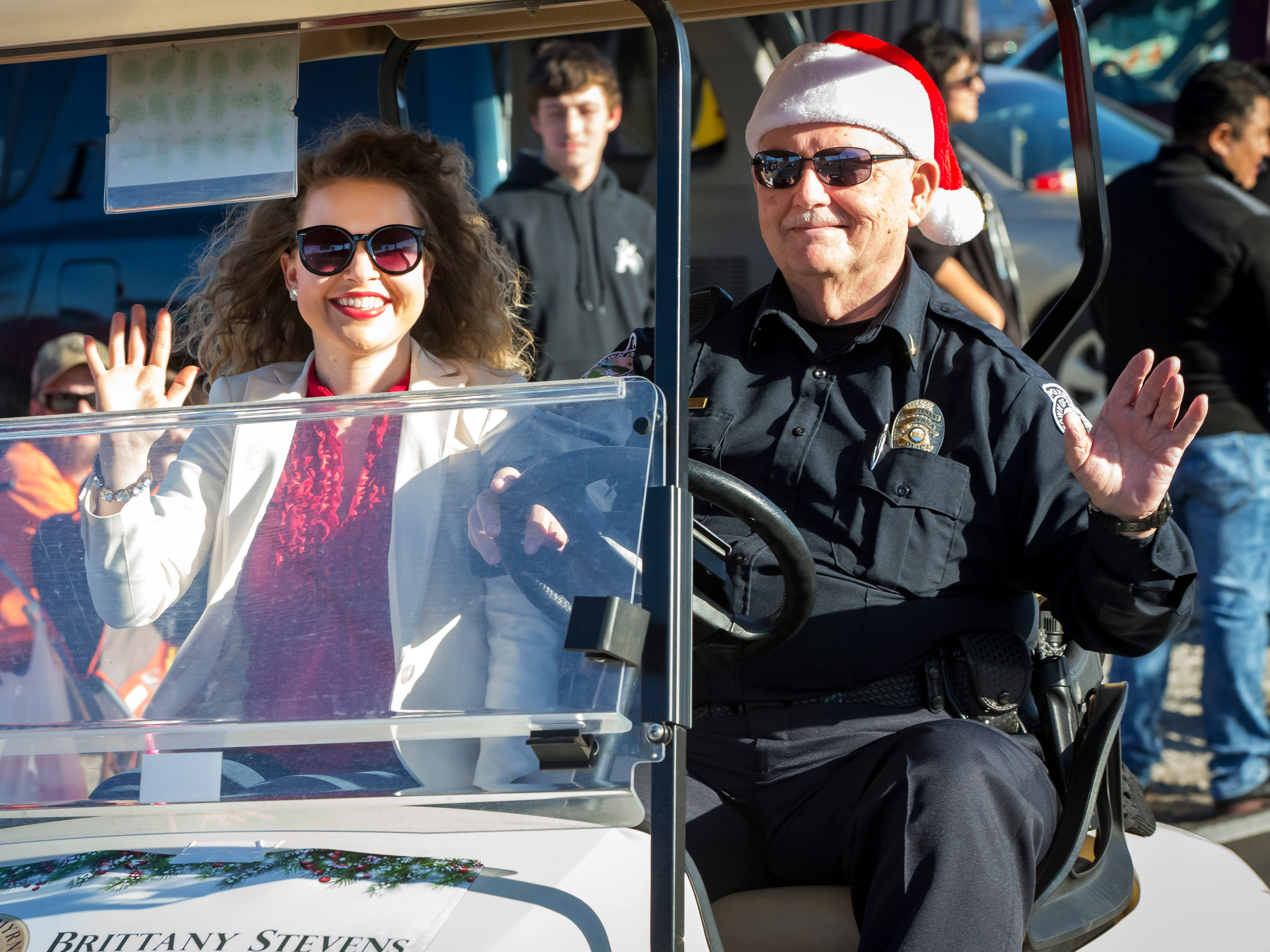 Smyrna's 44th annual Christmas parade was held Sunday, Dec. 2, 2018. Smyrna Town Court Clerk Brittany Stevens rides in a golf cart driven by a Smyrna police officer.