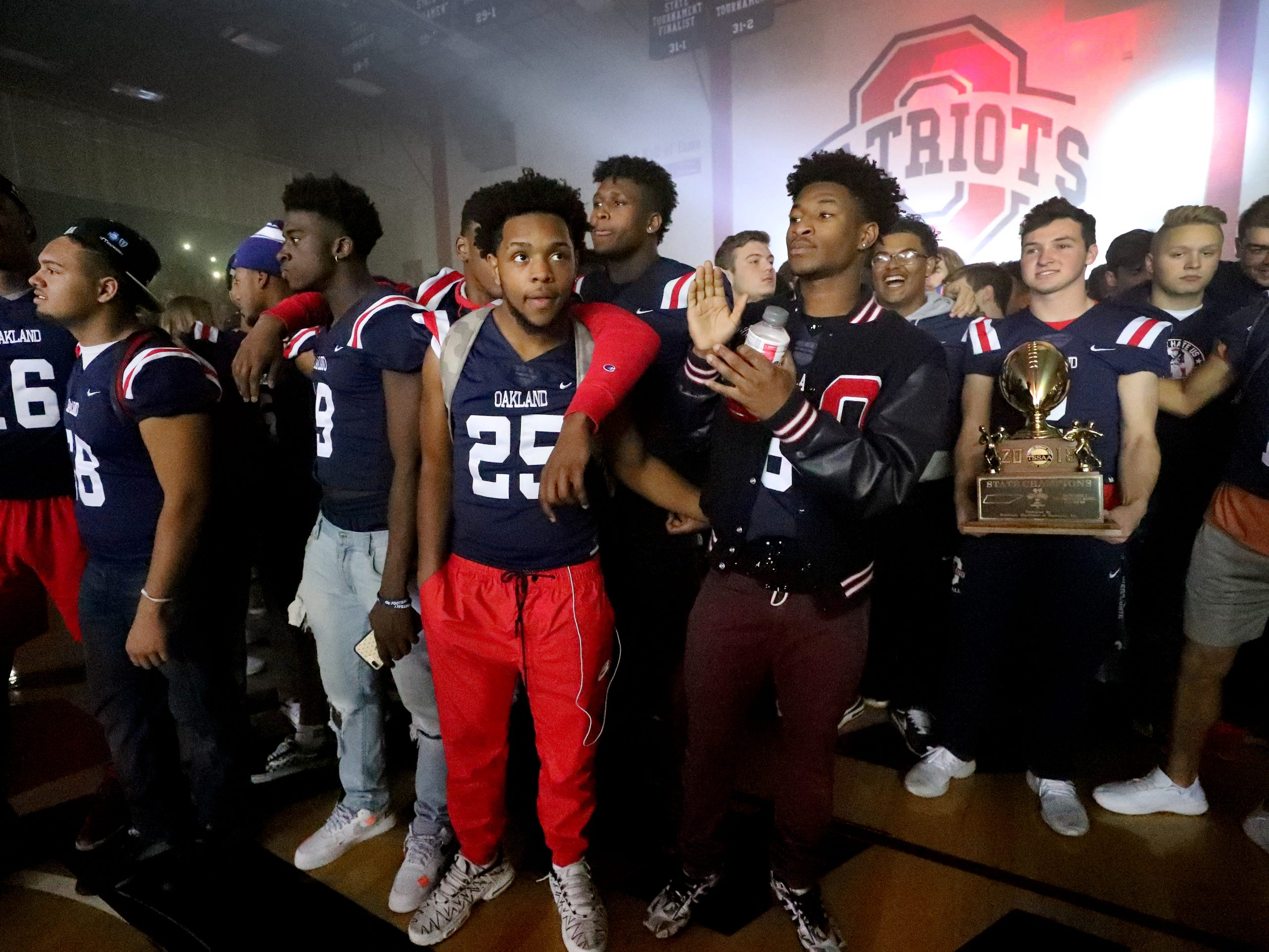Oakland High School football players celebrate during a pep rally, on Monday, Dec. 3, 2018 at the school after the football team won the 6A State Championship BlueCross Bowl game against Westhaven on Thursday.