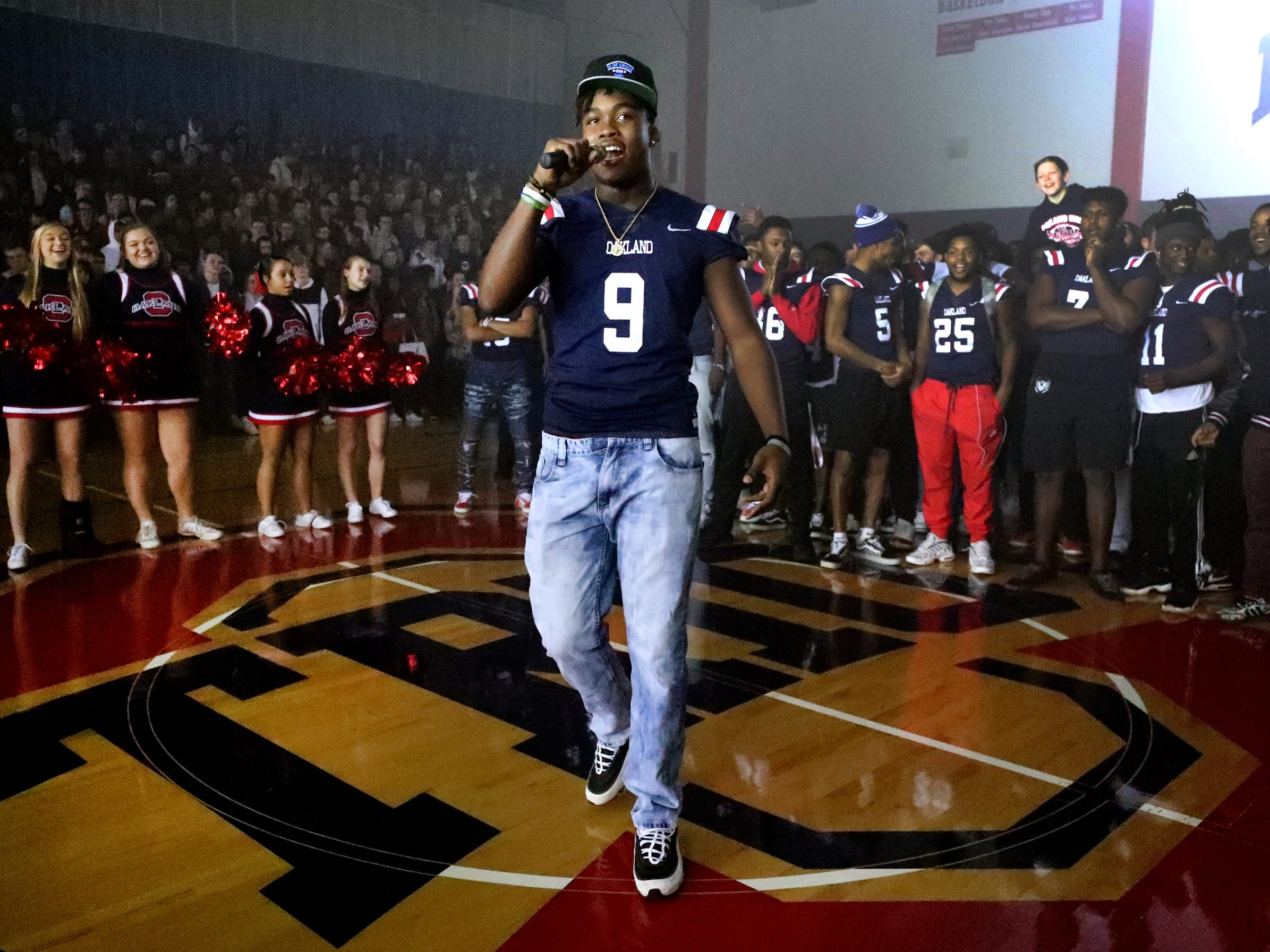Oakland High School football player and senior Tekoy Randolph (9) speaks to the student body during a pep rally, on Monday, Dec. 3, 2018 at the school after the football team won the 6A State Championship BlueCross Bowl game against Westhaven on Thursday.