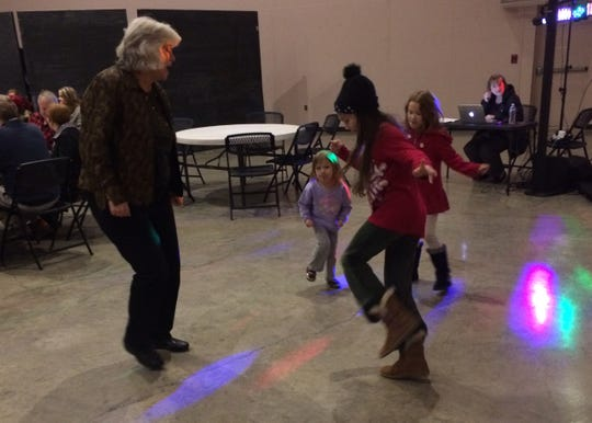Visitors at Chris Russell's retirement event having a good time Thursday night at Restoration Church.