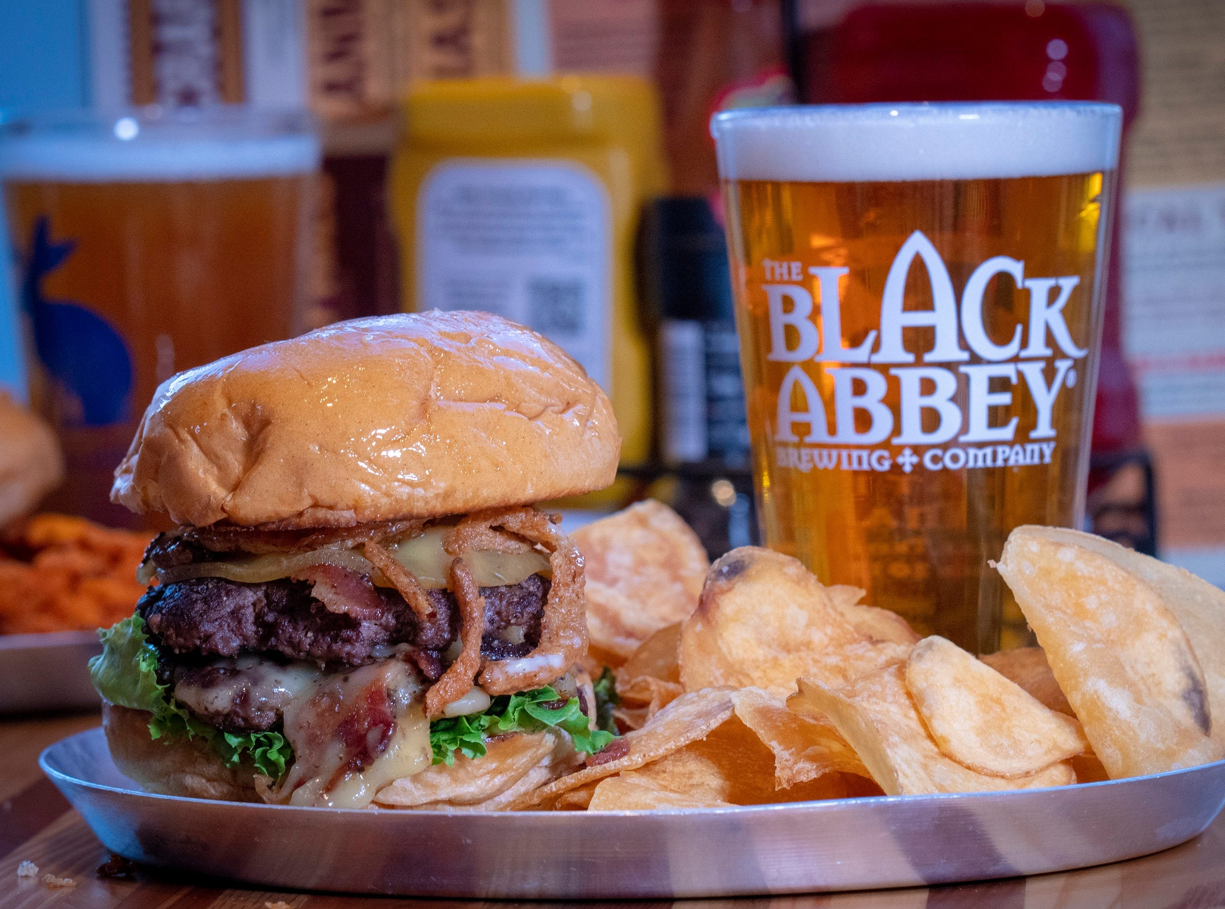 The Belgian smashed double patty stack with smoked Gouda, onions, bacon and garlic peppercorn aioli with Black Abbey's Belgian blonde ale, The Rose.