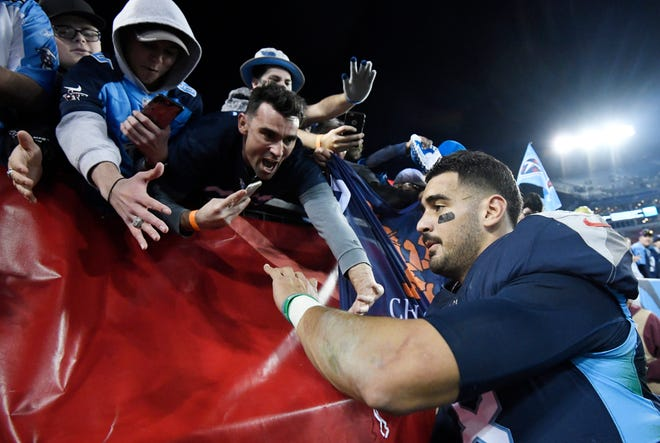 Fans reach for Titans quarterback Marcus Mariota (8) after the team's 26-22 win over the Jets on Dec. 2 at Nissan Stadium.