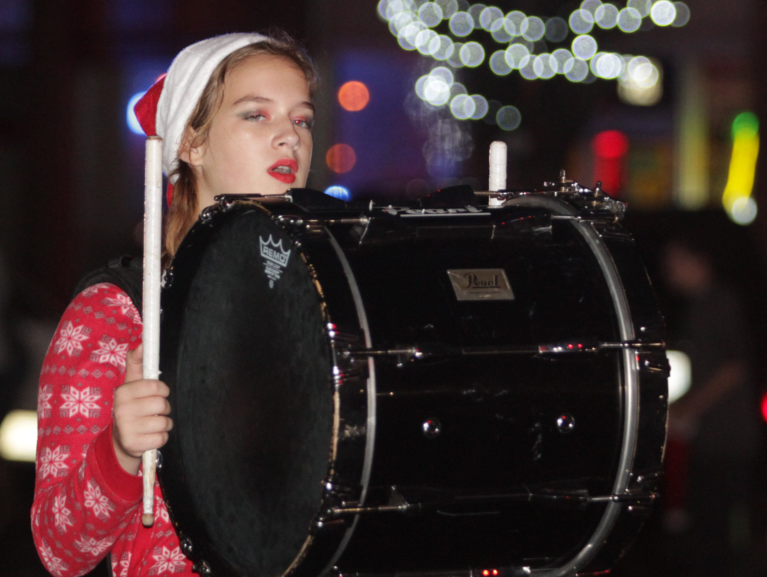 A drummer from the Cheatham County High School band marches in the Ashland City xmas parade on Saturday, December 1, 2018.