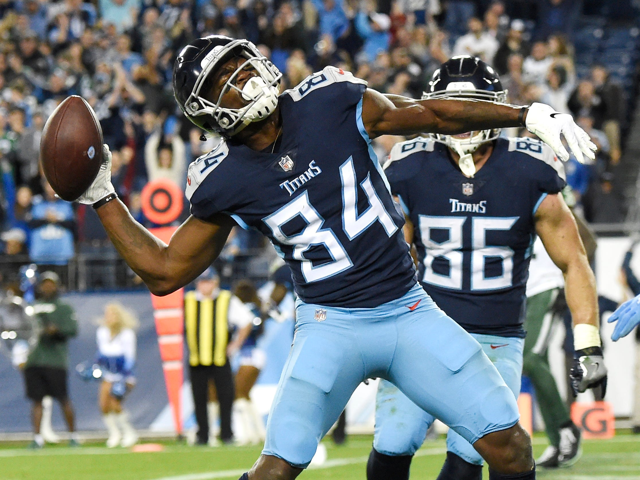 Titans wide receiver Corey Davis (84) celebrates his game-winning touchdown in the fourth quarter at Nissan Stadium Sunday, Dec. 2, 2018, in Nashville, Tenn.