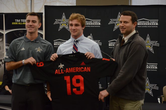 Christ Presbyterian Academy linebacker Kane Patterson (middle) was presented with an honorary 2019 All-American Bowl jersey on Monday.