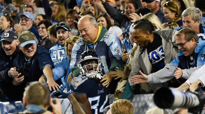 Titans wide receiver Corey Davis (84) celebrates his touchdown against the Jets with fans at Nissan Stadium Sunday, Dec. 2, 2018, in Nashville, Tenn.