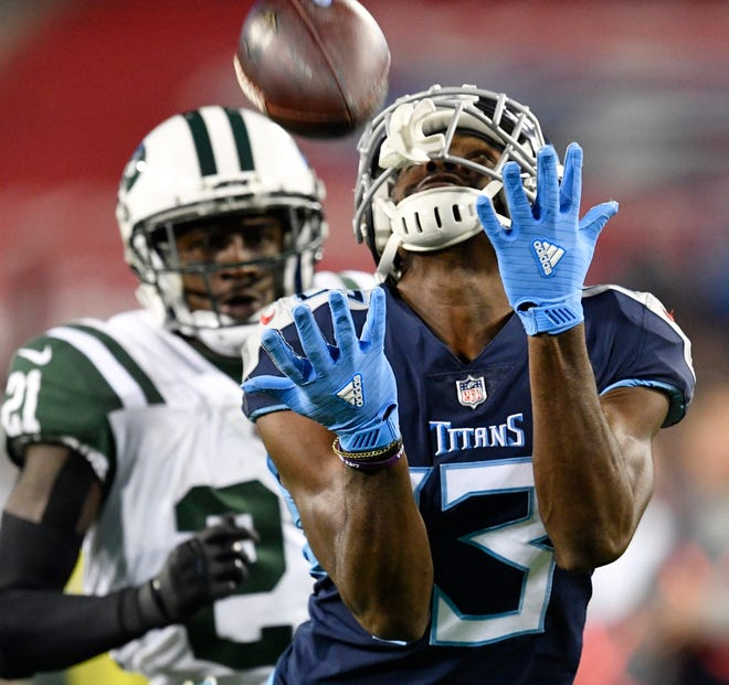 Titans wide receiver Taywan Taylor (13) makes a catch late in the fourth quarter Sunday.