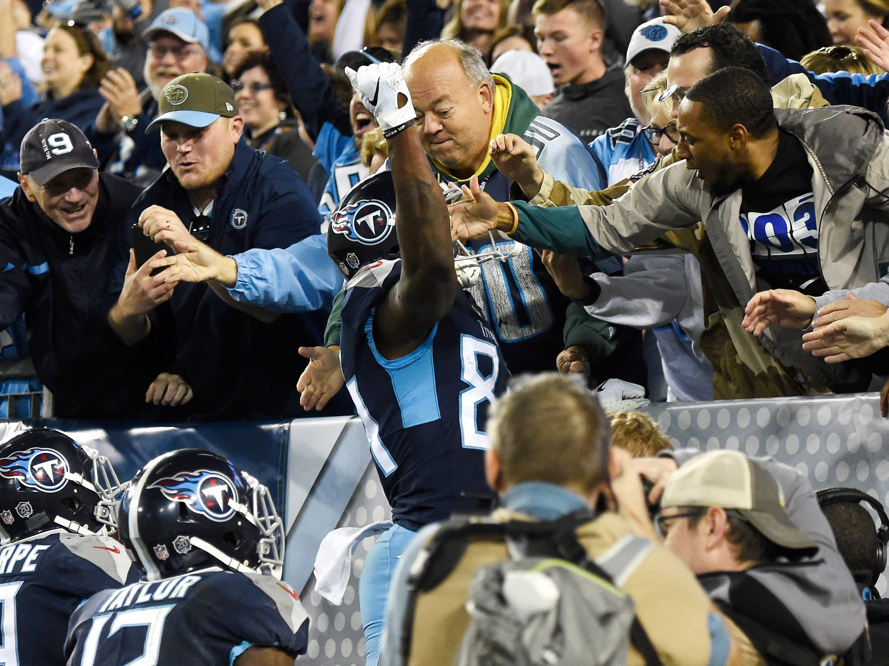 Titans wide receiver Corey Davis (84) celebrates his touchdown with fans in the fourth quarter at Nissan Stadium Sunday, Dec. 2, 2018, in Nashville, Tenn.