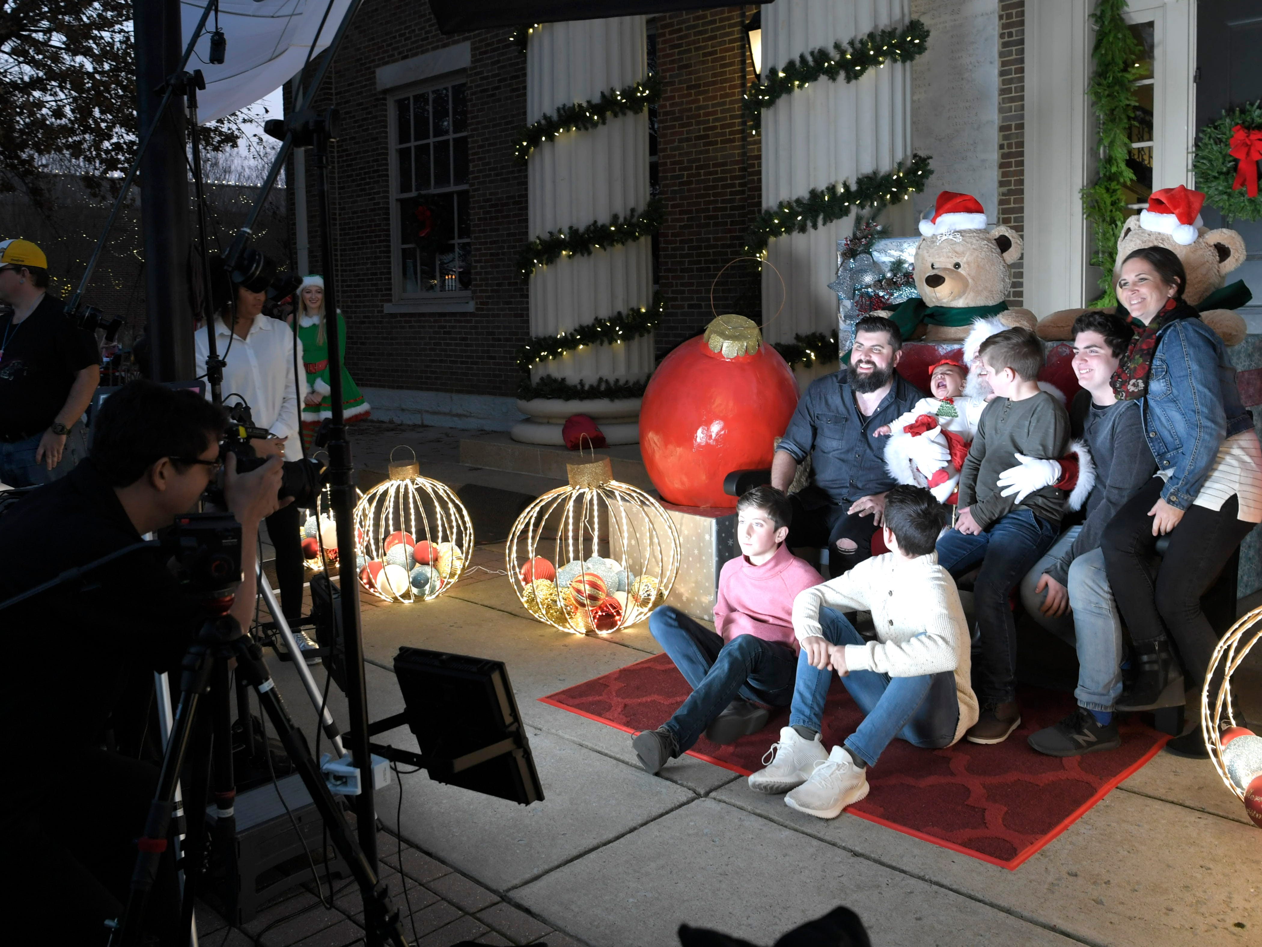 The Clayton family of Spring Hill gets a family photo with Santa during the Franklin's annual Christmas Tree Lighting on Sunday, Dec. 2, 2018.