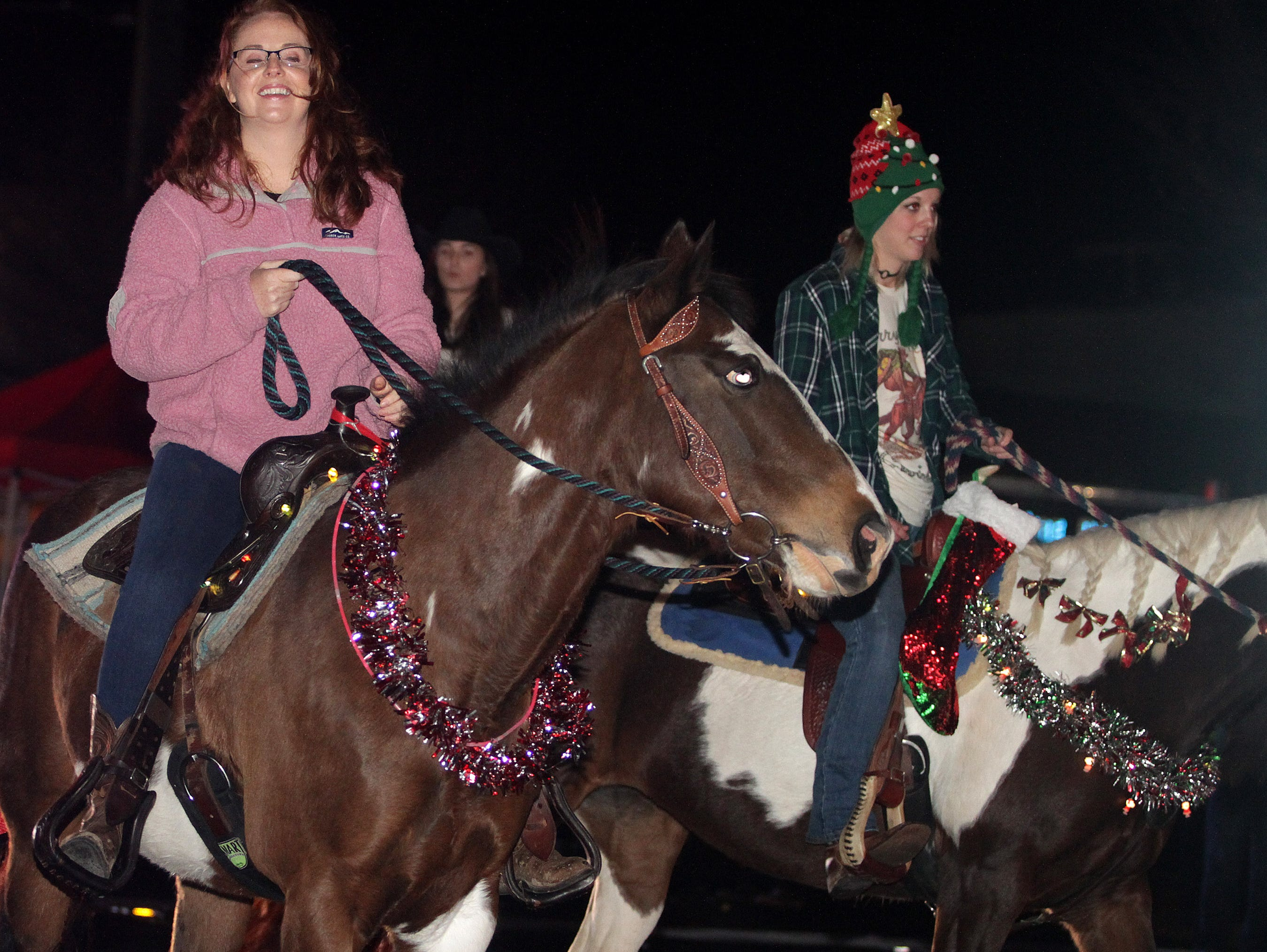 Folks ride horses at the Ashland City xmas parade on Saturday, December 1, 2018.