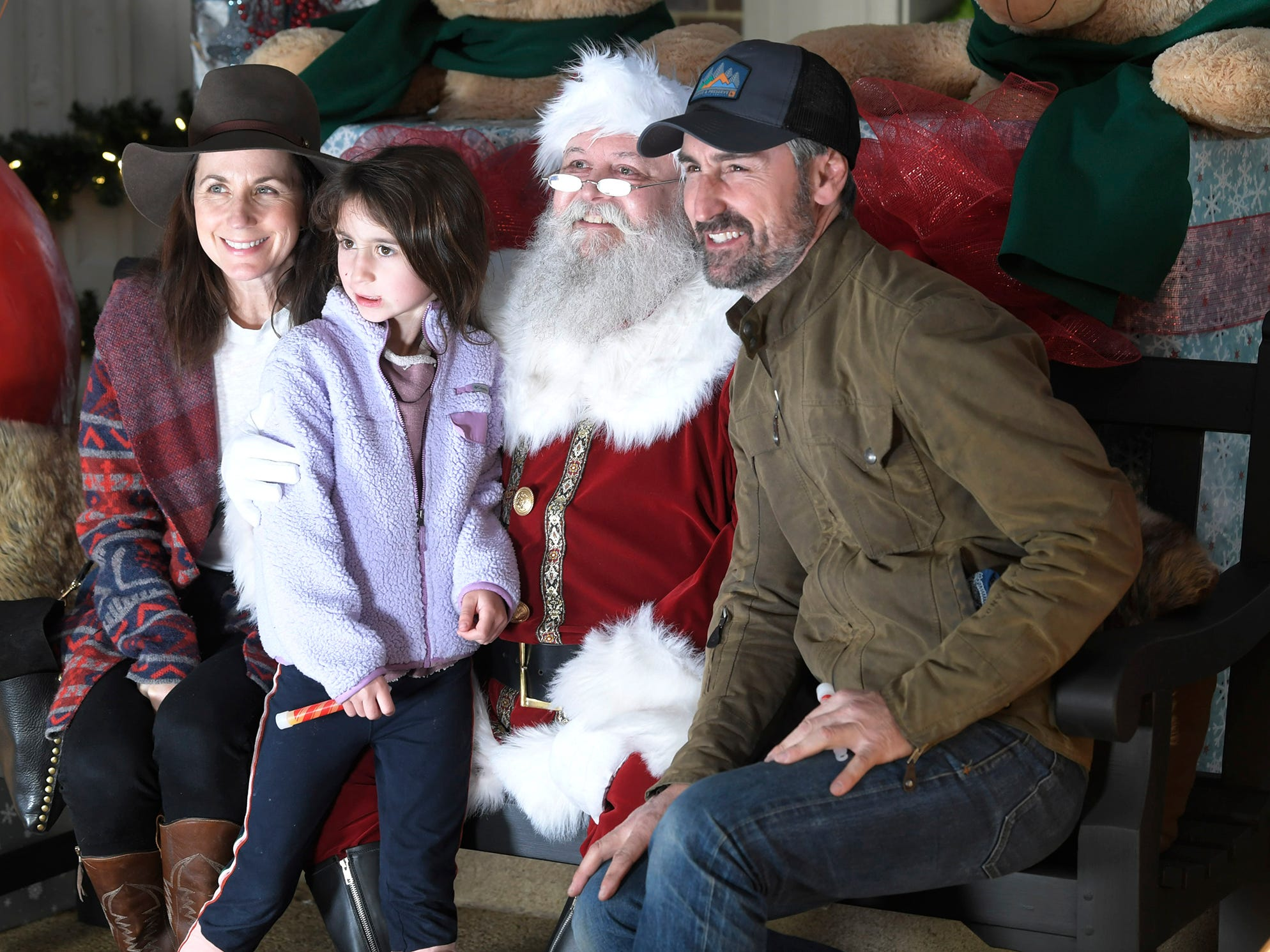 American Pickers host Mike Wolfe and his family sit  with Santa for a photograph during the Franklin's  annual Christmas Tree Lighting on Sunday, Dec. 2, 2018.