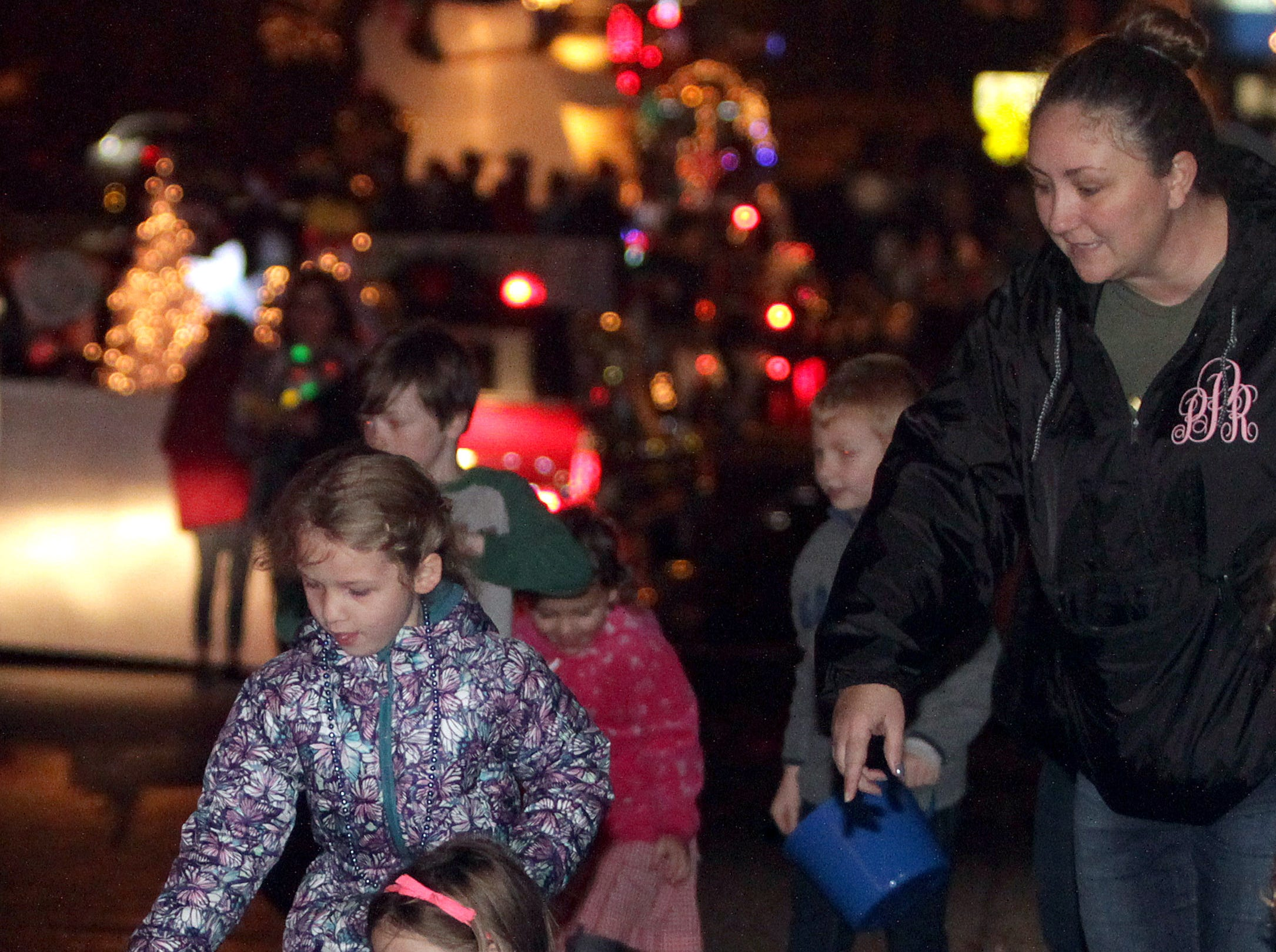 Kids gather candy throw at the Ashland City xmas parade on Saturday, December 1, 2018.