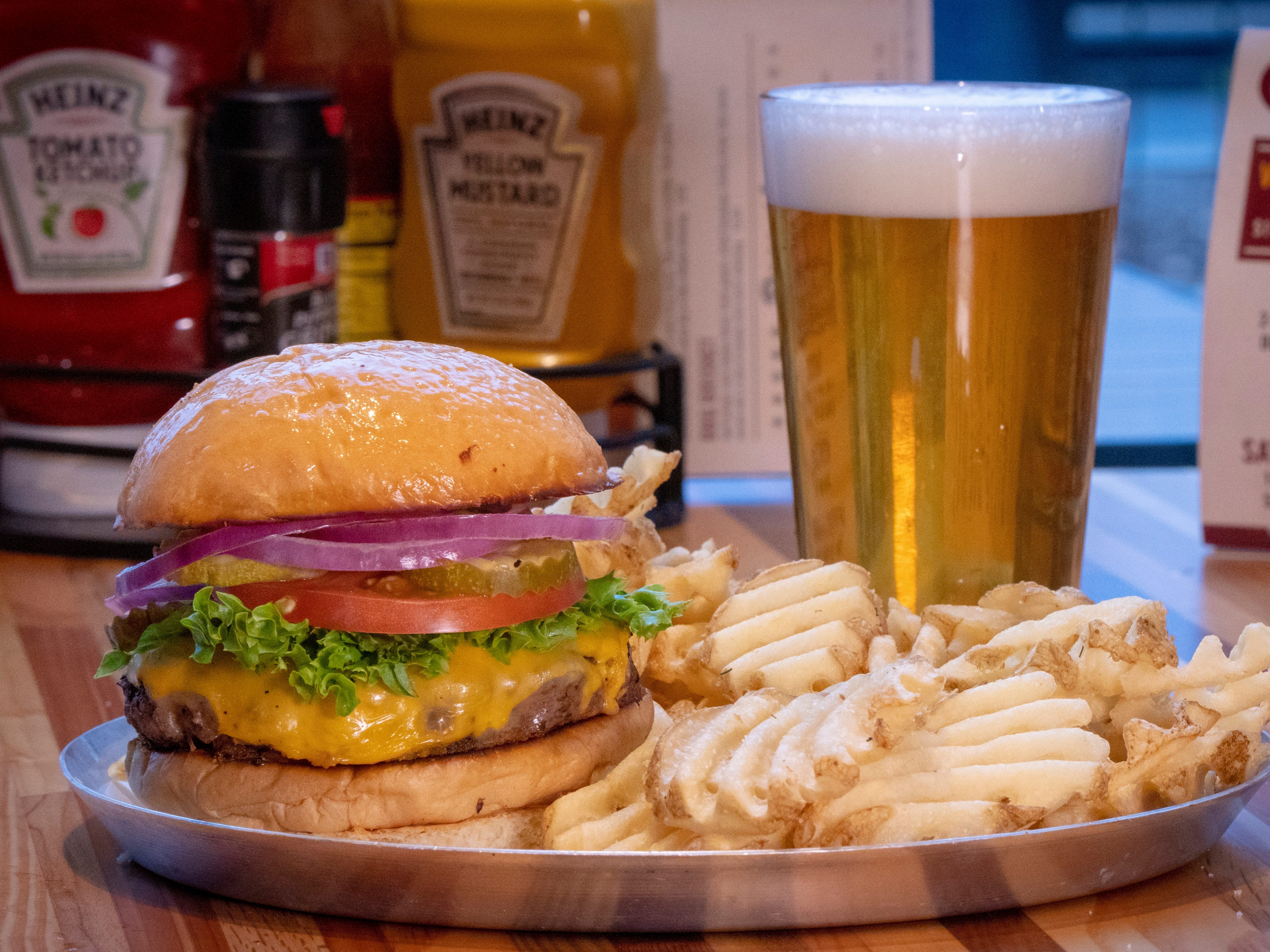 M.L.Rose cheeseburger with waffle fries and a Yazoo Pale Ale.