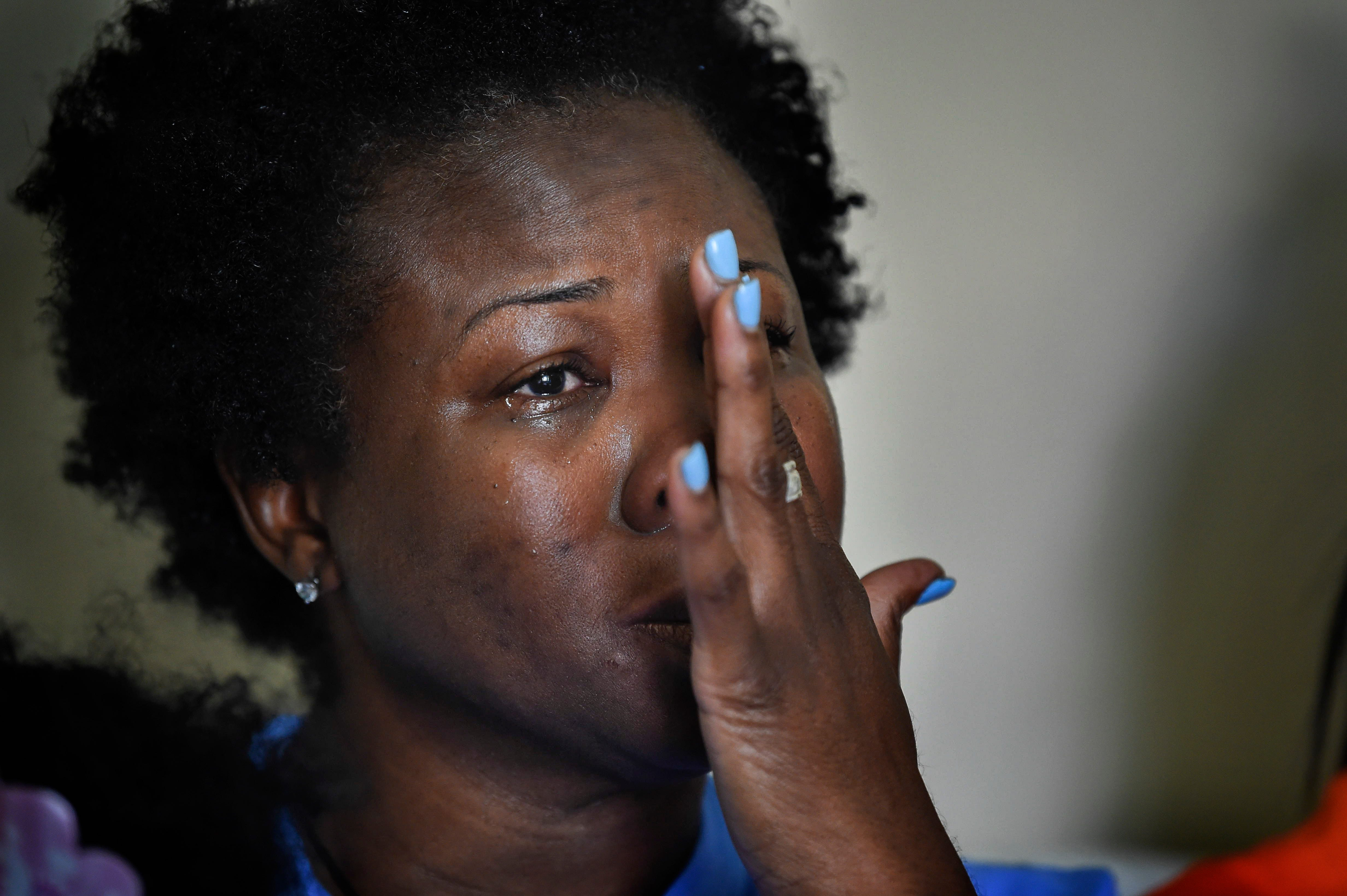 Shaundelle Brooks, the mother of Waffle House shooting victim Akilah Dasilva, cries as she talks about the loss of her son.