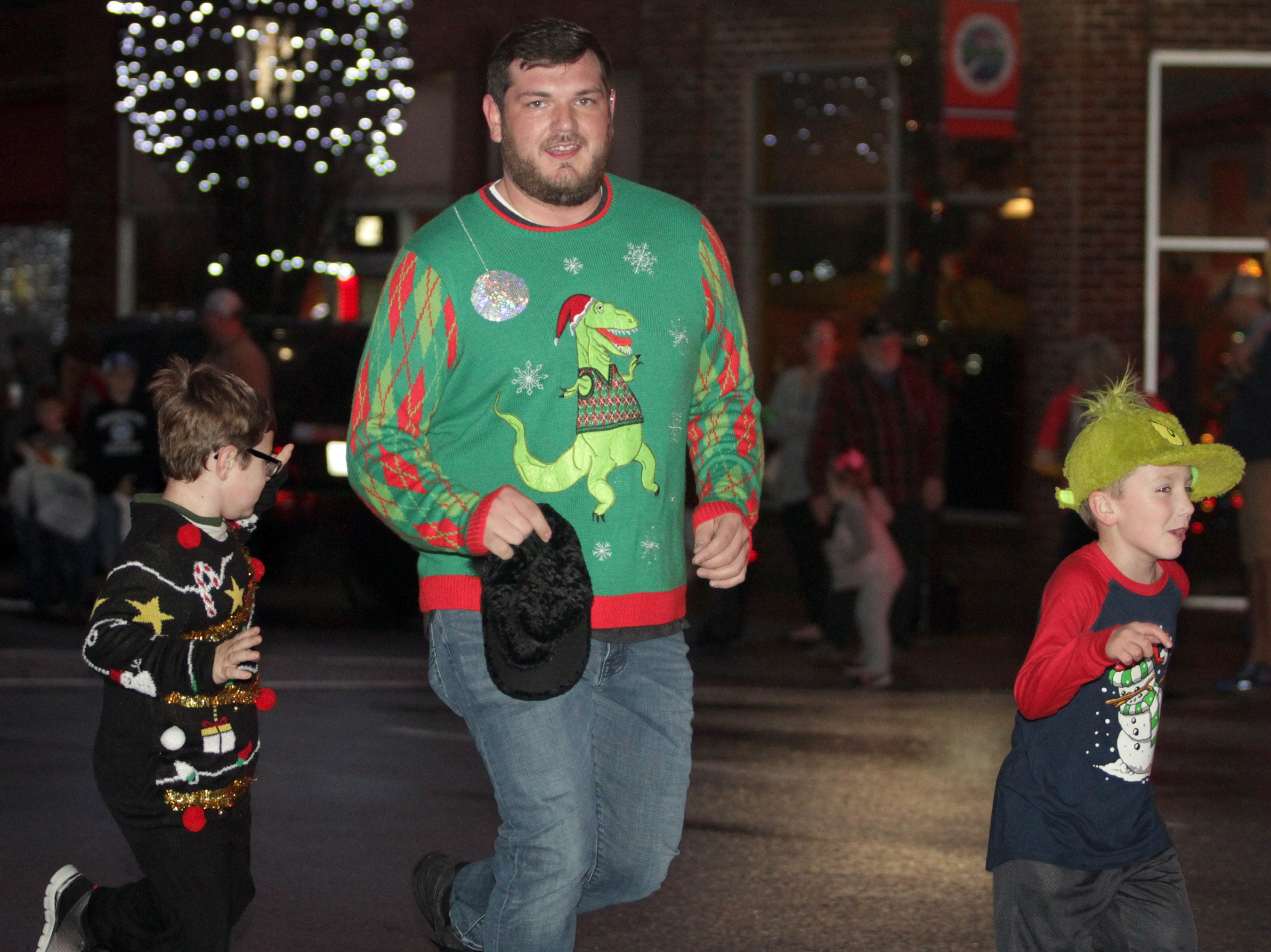 The start of the Ashland City xmas parade featured runners in ugly xmas sweaters on Saturday, December 1, 2018.