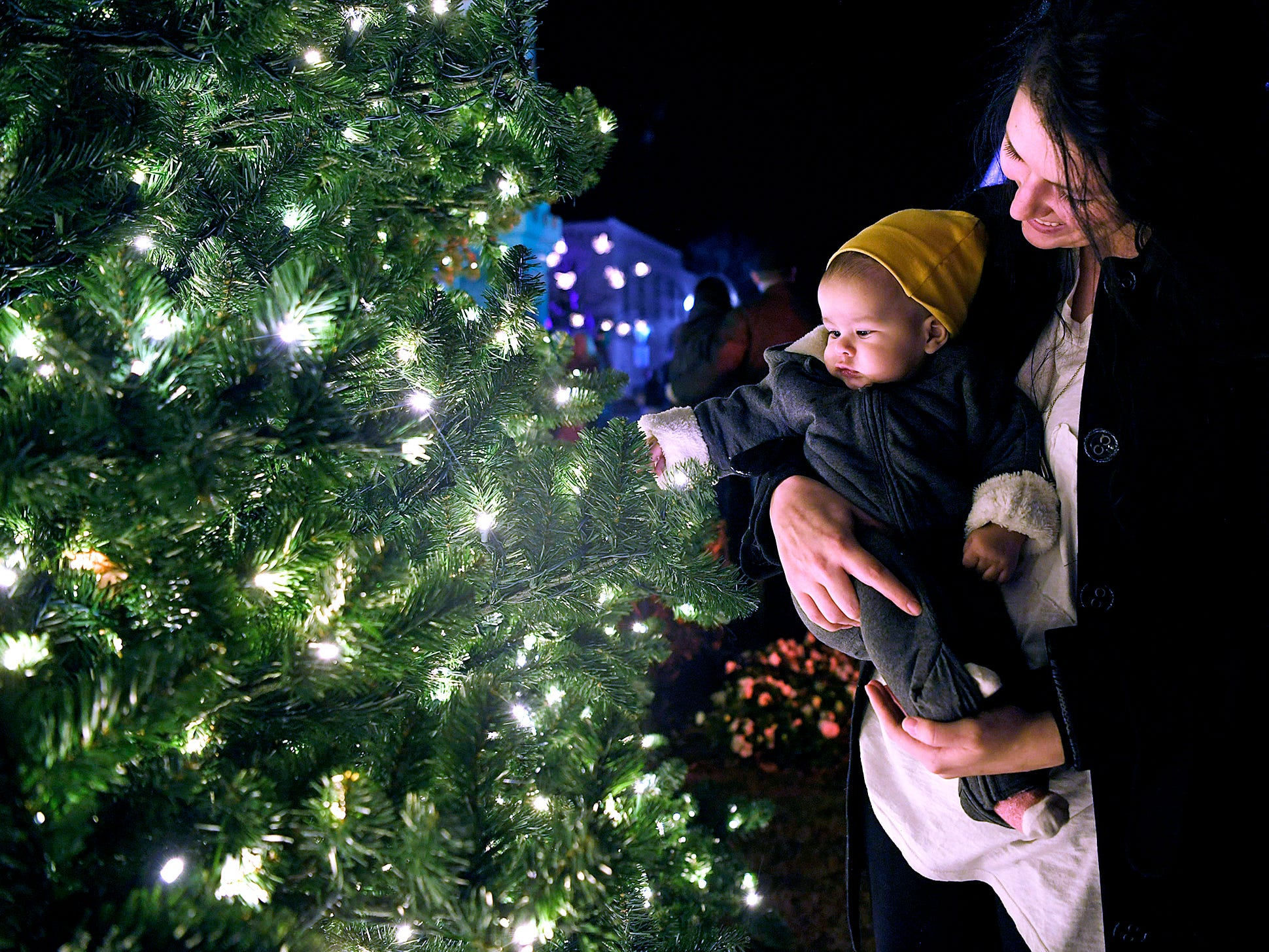 Meg Urbina holds her eight-month-old son, Judah, during Franklin's annual Christmas Tree Lighting on Sunday, Dec. 2, 2018.