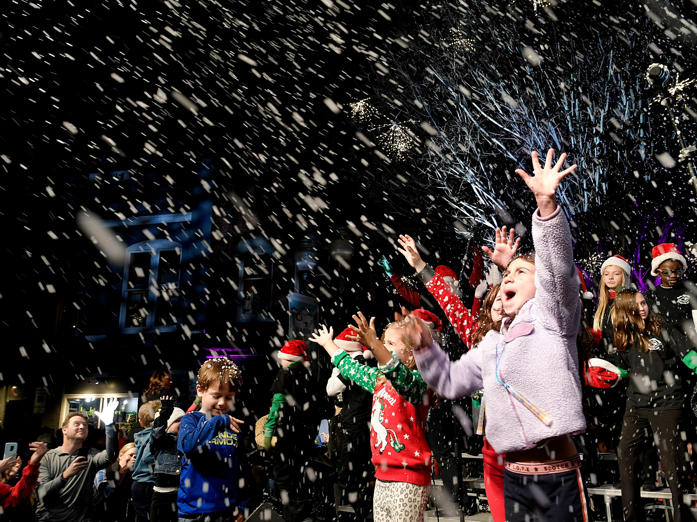 Children play in fake snow during the Franklin's annual Christmas Tree Lighting on Sunday, Dec. 2, 2018.