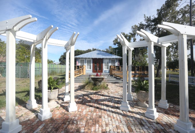 Renovations on the century-old McSwain House in downtown Bonita Springs are nearly finished. The front pillar area sits near the sidewalk to draw visitors.