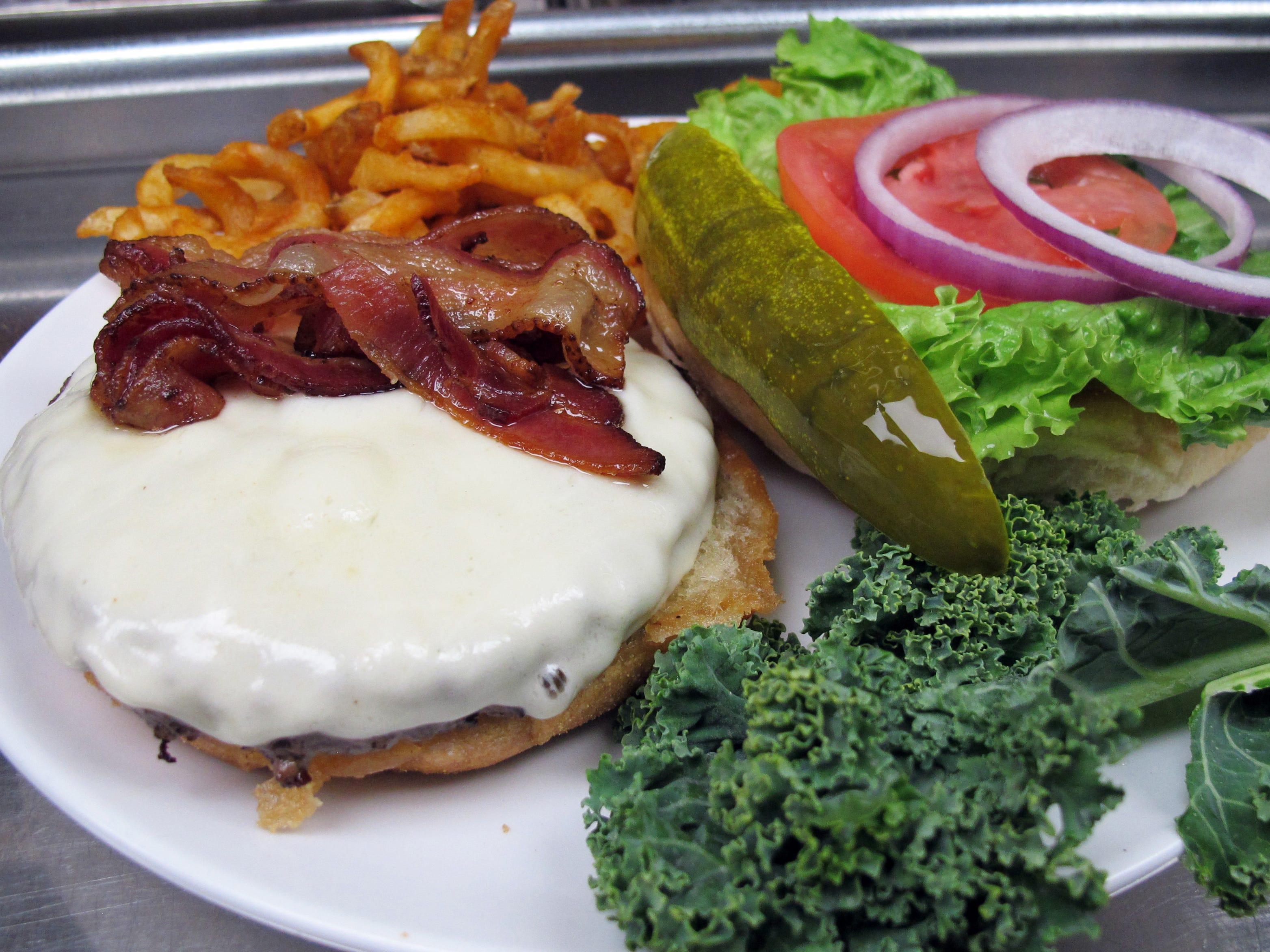The Balloon Burger with bacon and cheese at the Bonita Beach Balloon Bar & Grill on Bonita Beach Road in Bonita Springs.