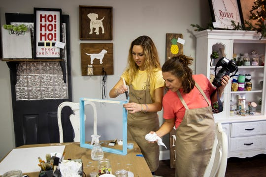 Taylor Bouchard and her mother Emily Bouchard work on a project during a fundraiser on Sunday, December 2, 2018, at Aerie Lane in Bonita Springs.