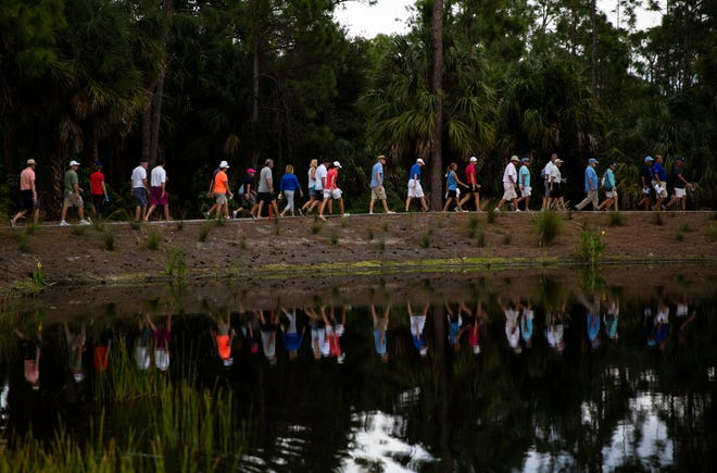Spectators walk between holes during the CME Championship on Sunday, November 18, 2018, at Tiburón Golf Club in Naples.