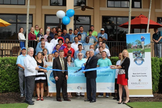 Employees of Eagle Creek Golf & Country Club celebrate joining the Blue Zones Project.