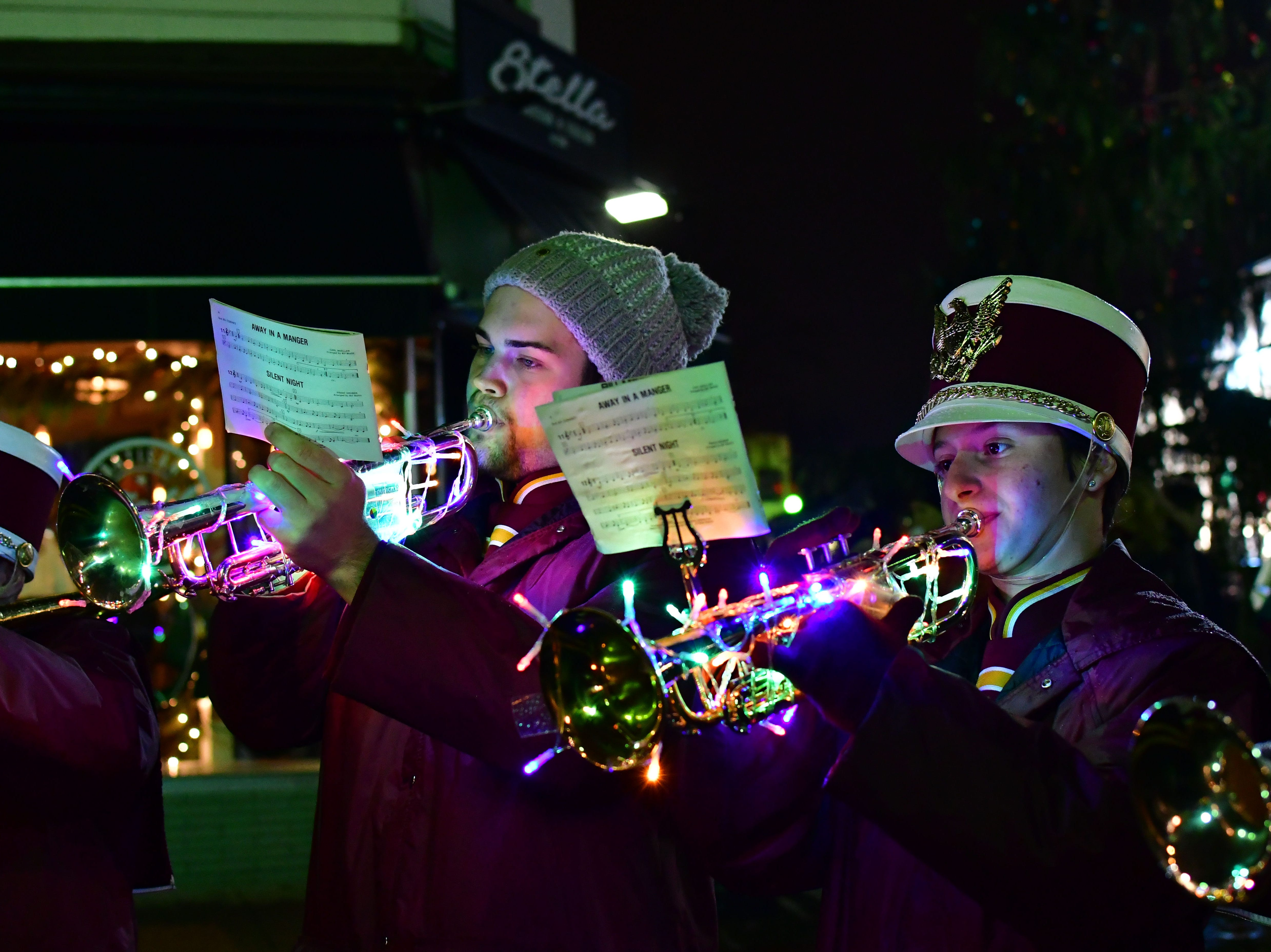 Matthew McCoy, left, and Victoria Schecter, right.  Holiday festivities along East Ridgewood Avenue in Ridgewood on Nov. 30.