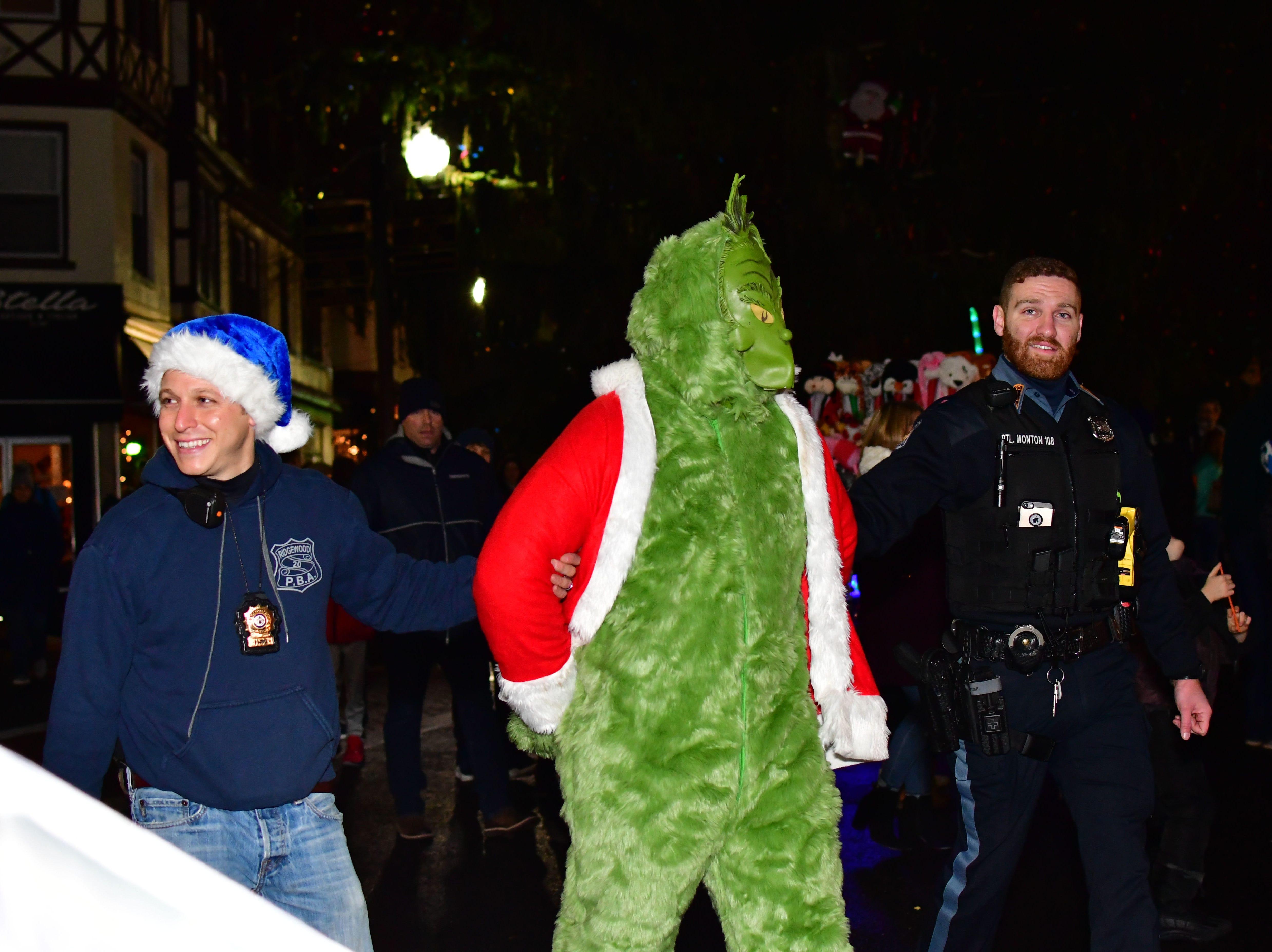 Grinch arrested.  Holiday festivities along East Ridgewood Avenue in Ridgewood on Nov. 30.