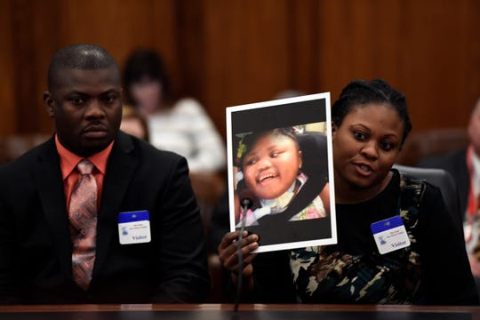 Ocroimy Dolcin and his wife Modeline Auguste talk about their four-year-old daughter Dorcase Dolcin, one of the 11 children who died as a result of the adenovirus outbreak at the Wanaque Center for Nursing and Rehabilitation. The Health and Human Services Committee held a public hearing on Monday, Dec. 3, 2018, in Trenton.