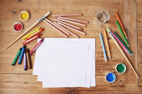 One experience gift idea is craft time together with a new art set or a copy of your favorite book from childhood to read together.