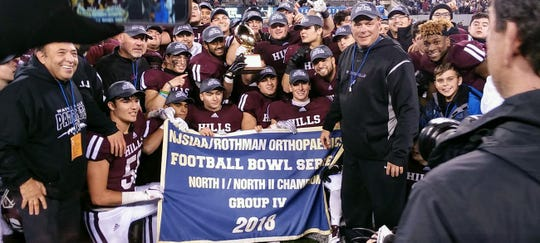 Wayne Hills players and coaches celebrating their North Group 4 football title.