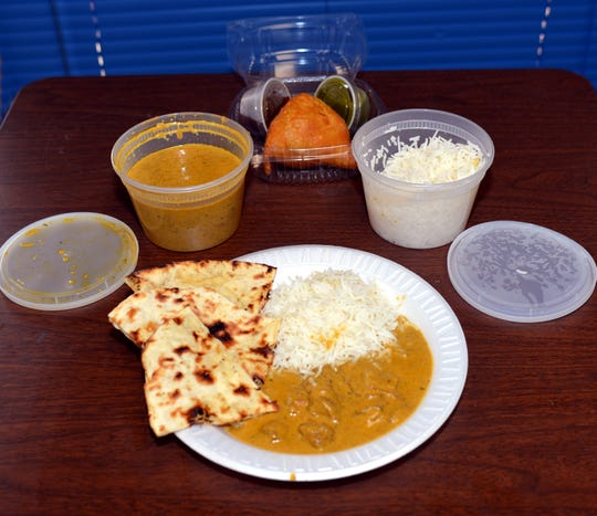 Samosa appetizer with buttered naan bread and Lamb Korma with white rice from Bombay Hut in Waldwick, New Jersey, shot Dec. 8, 2016.