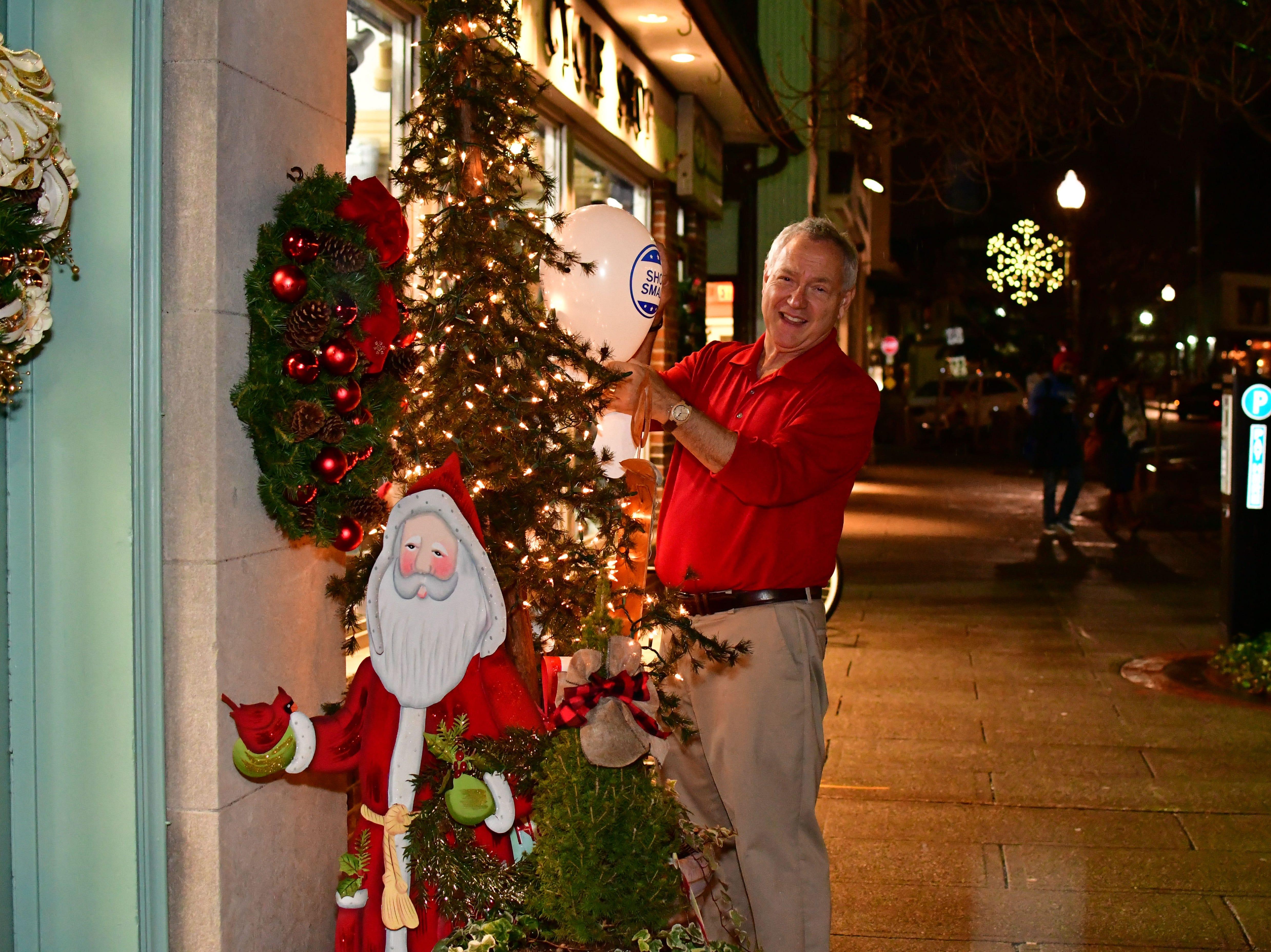 "Tony Damiano displays a balloon ""SHOP SMALL"".  Holiday festivities along East Ridgewood Avenue in Ridgewood on Nov. 30."