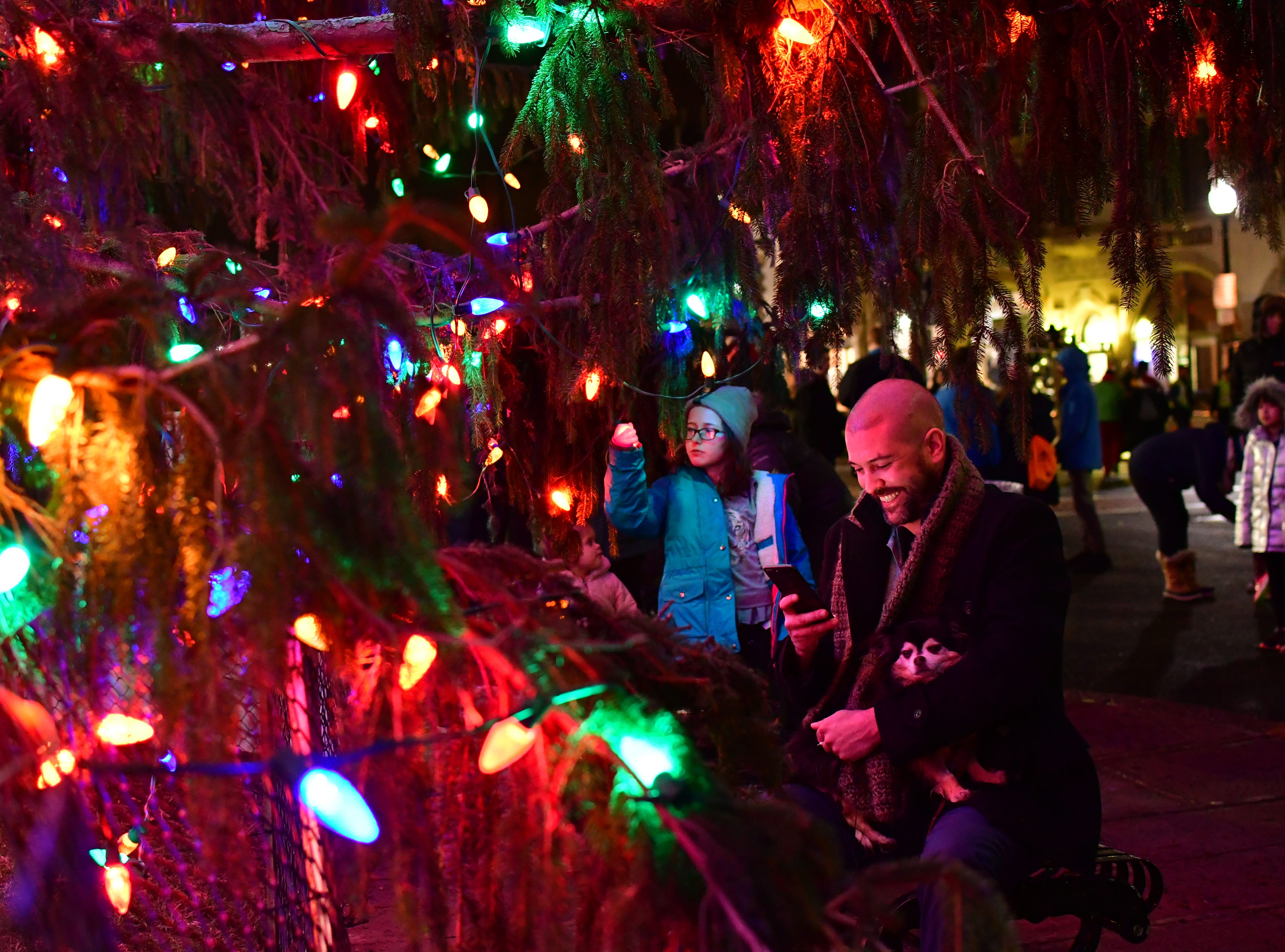 Charles Kreps, sits down on a bench by the newly lit tree. Holiday festivities along East Ridgewood Avenue in Ridgewood on Nov. 30.
