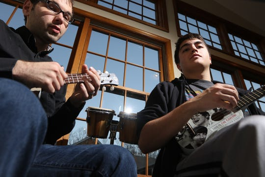 Shawn Reams, Owner / Director of North Jersey Guitar & Music Center, gives Brandon Diamond, 19, of Ringwood, a ukulele lesson in West Milford, Monday, December 3, 2018.