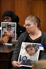 Paula Costigan, right, and Marie Beltran, left, hold photos of their children affected by the adenovirus outbreak at the Wanaque Center for Nursing and Rehabilitation. Families and their lawyer Paul da Costa (not pictured) attended the first public hearing in front of the Health and Human Services Committee on Monday, Dec. 3, 2018, in Trenton.